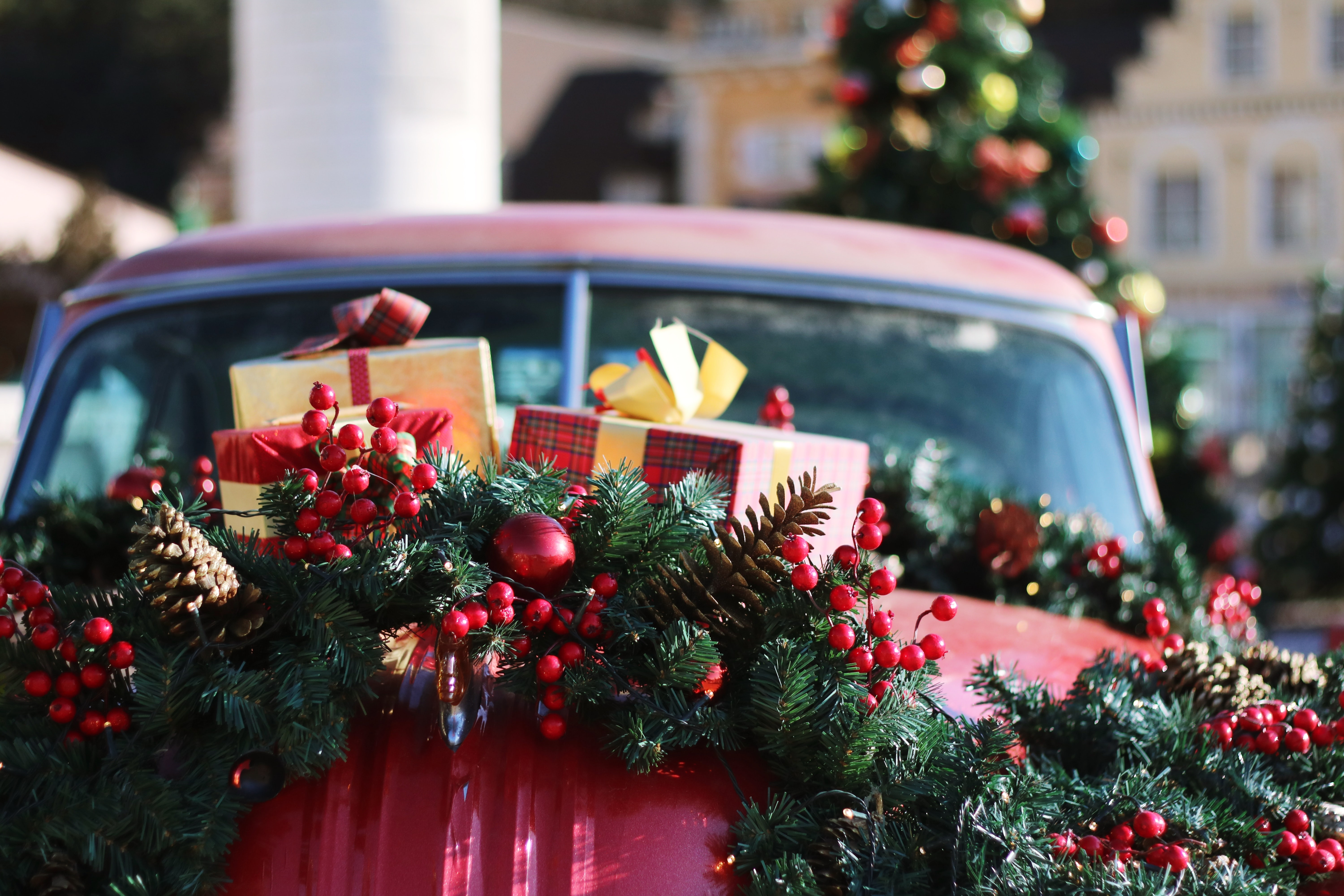 green and red wreath on red car