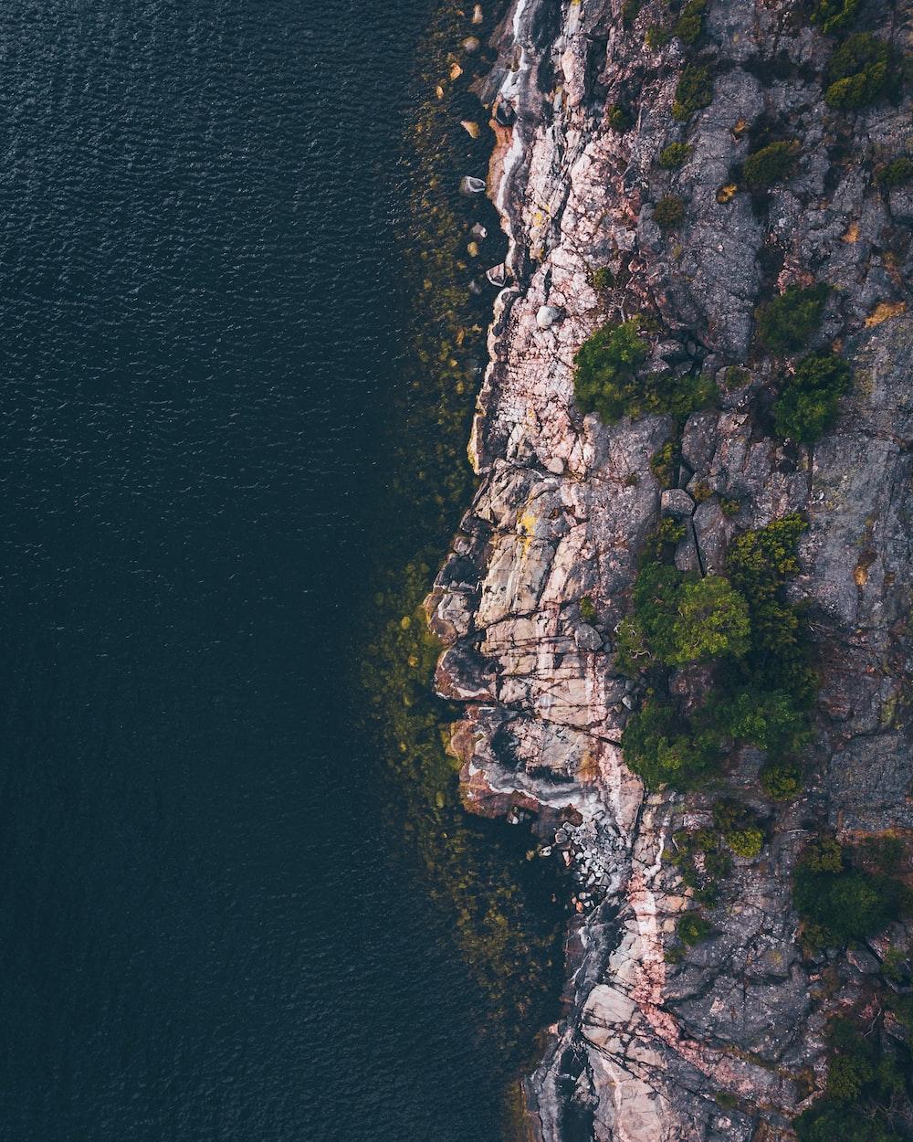 aerial photography of mountain near beach