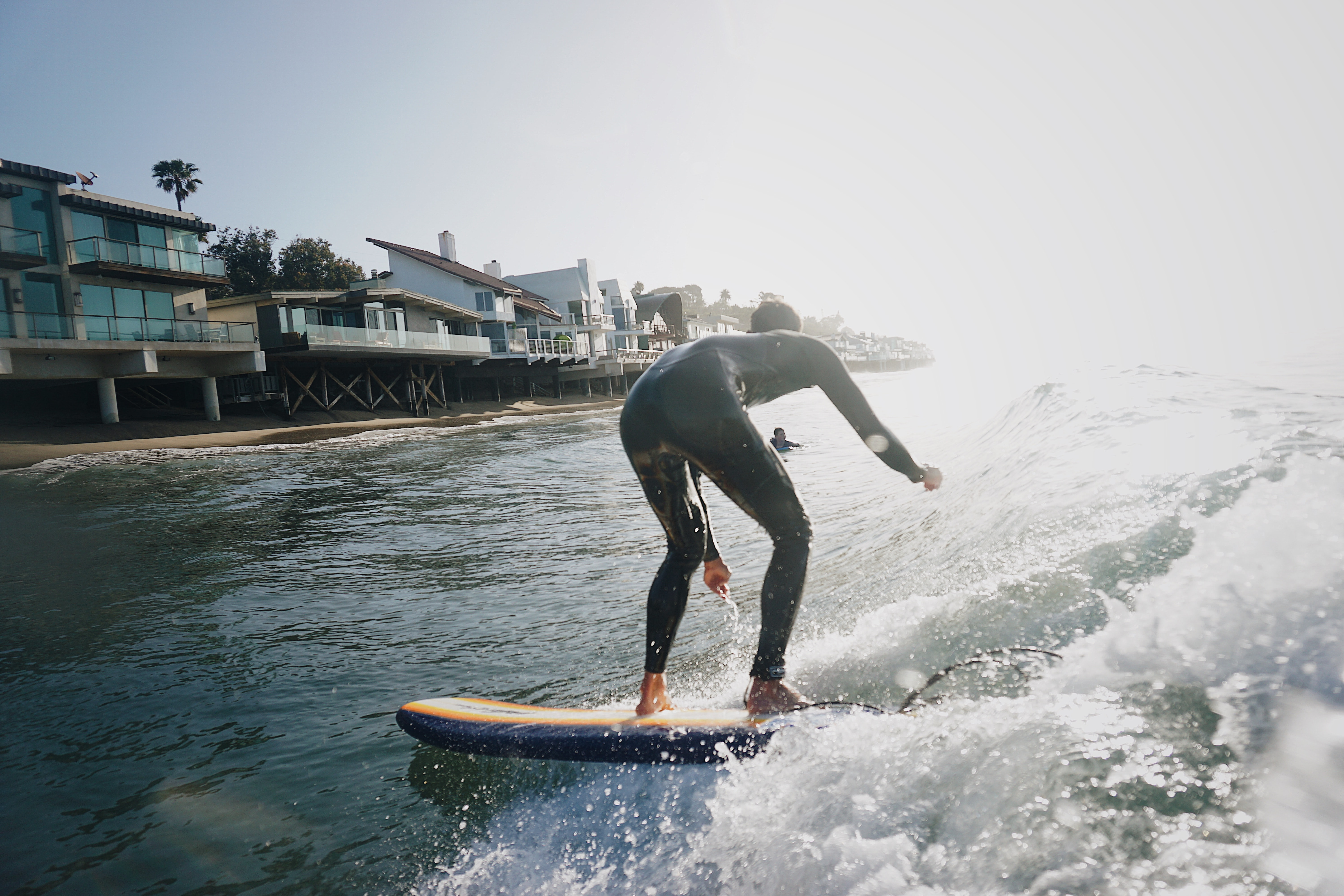 man on surfboard on body of water