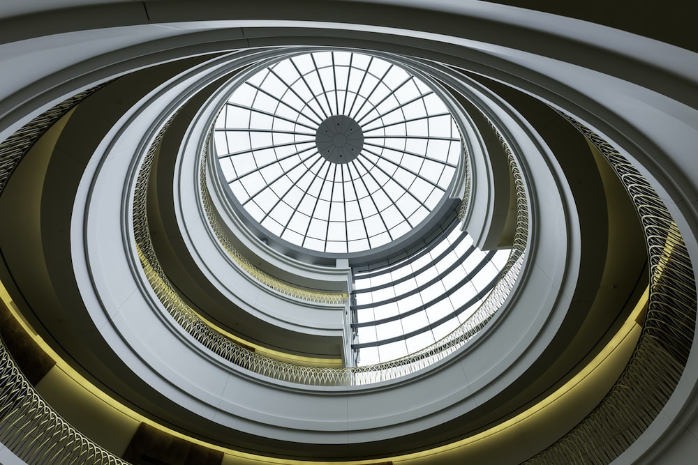 bottom view photo of spiral stair dome building