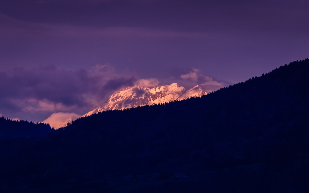 silhouette of mountain under purple sky at daytime