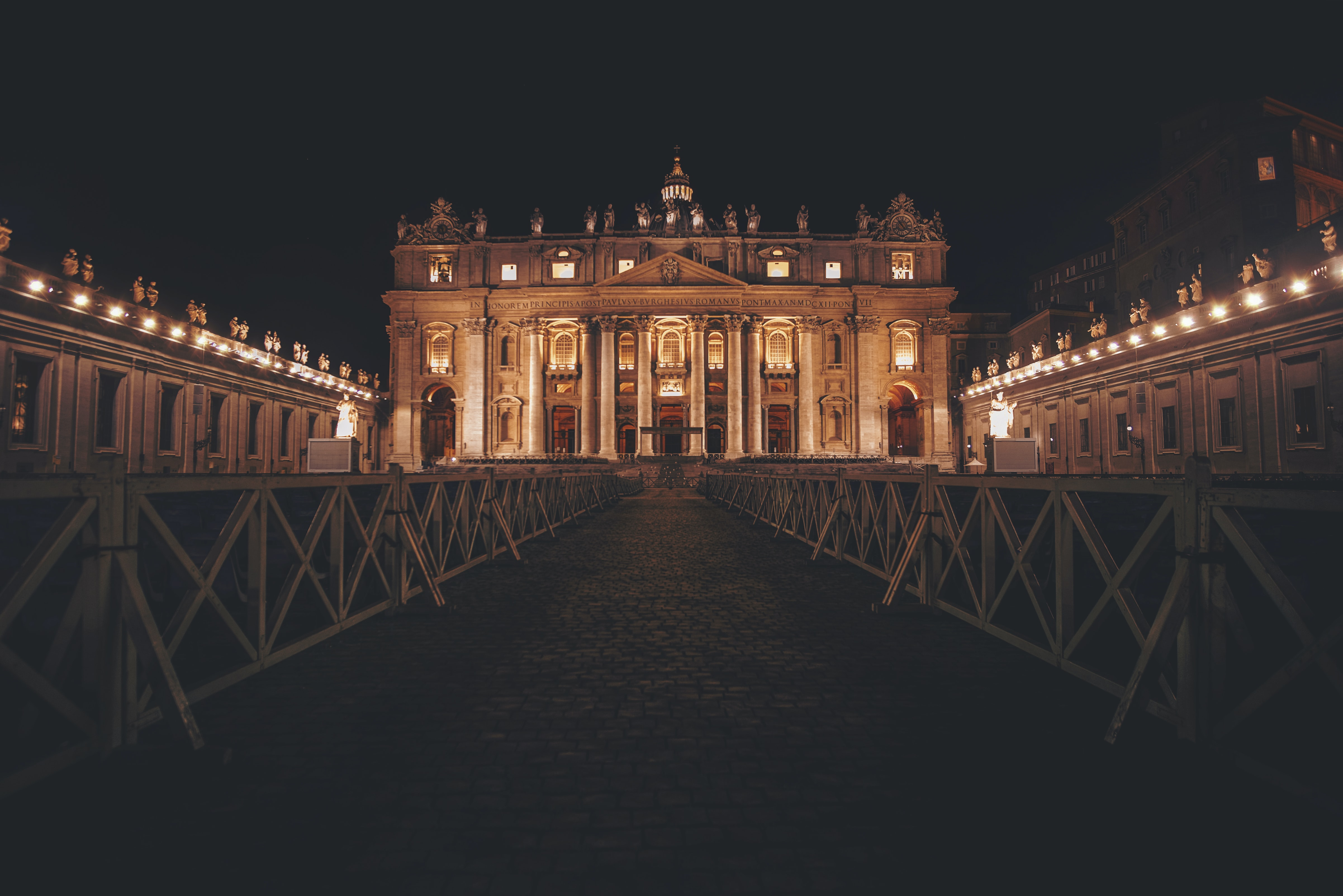 pathway leading to Saint Peter's Basilica at night time