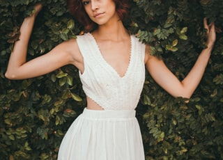woman wearing white sleeveless top