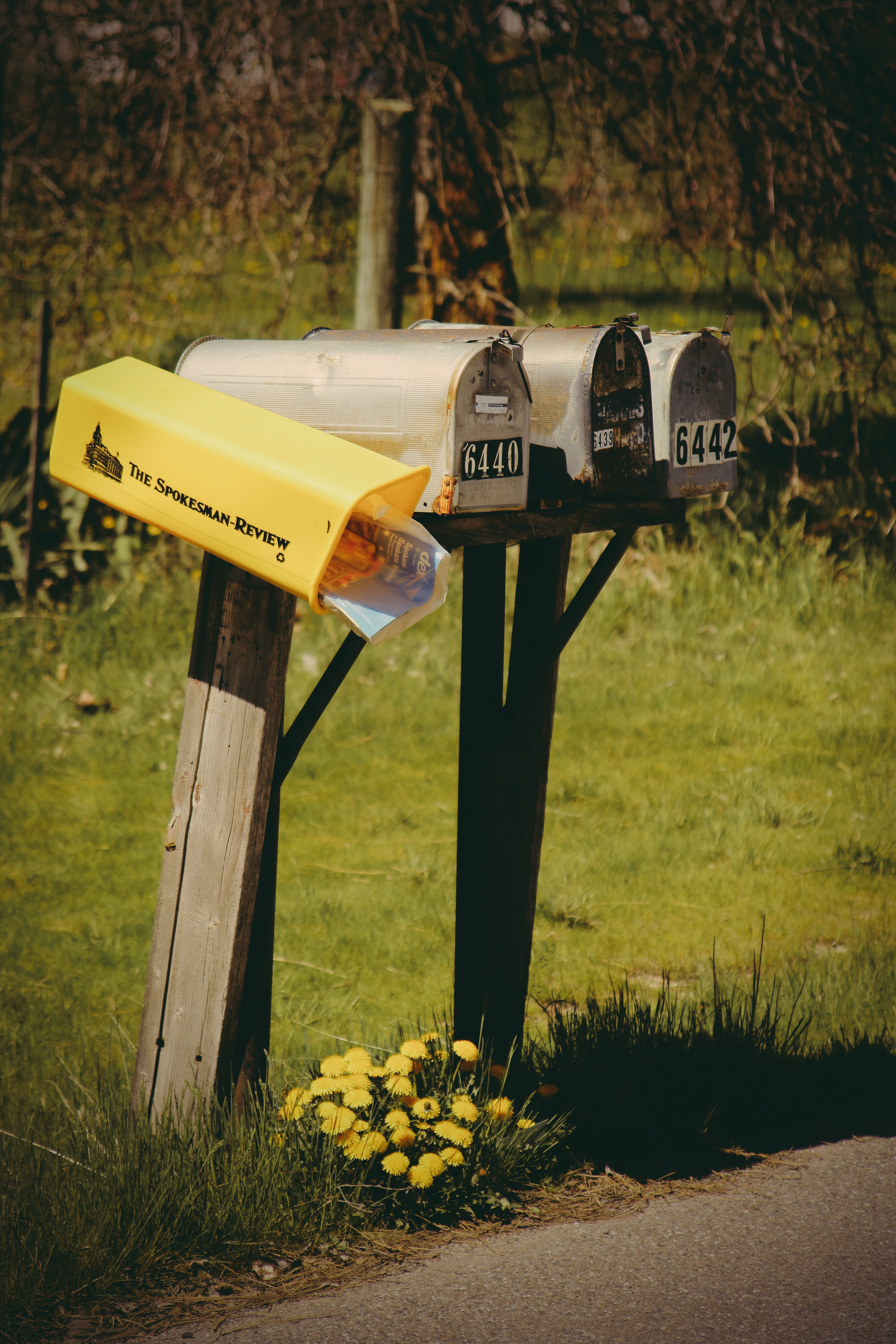 four gray mail boxes