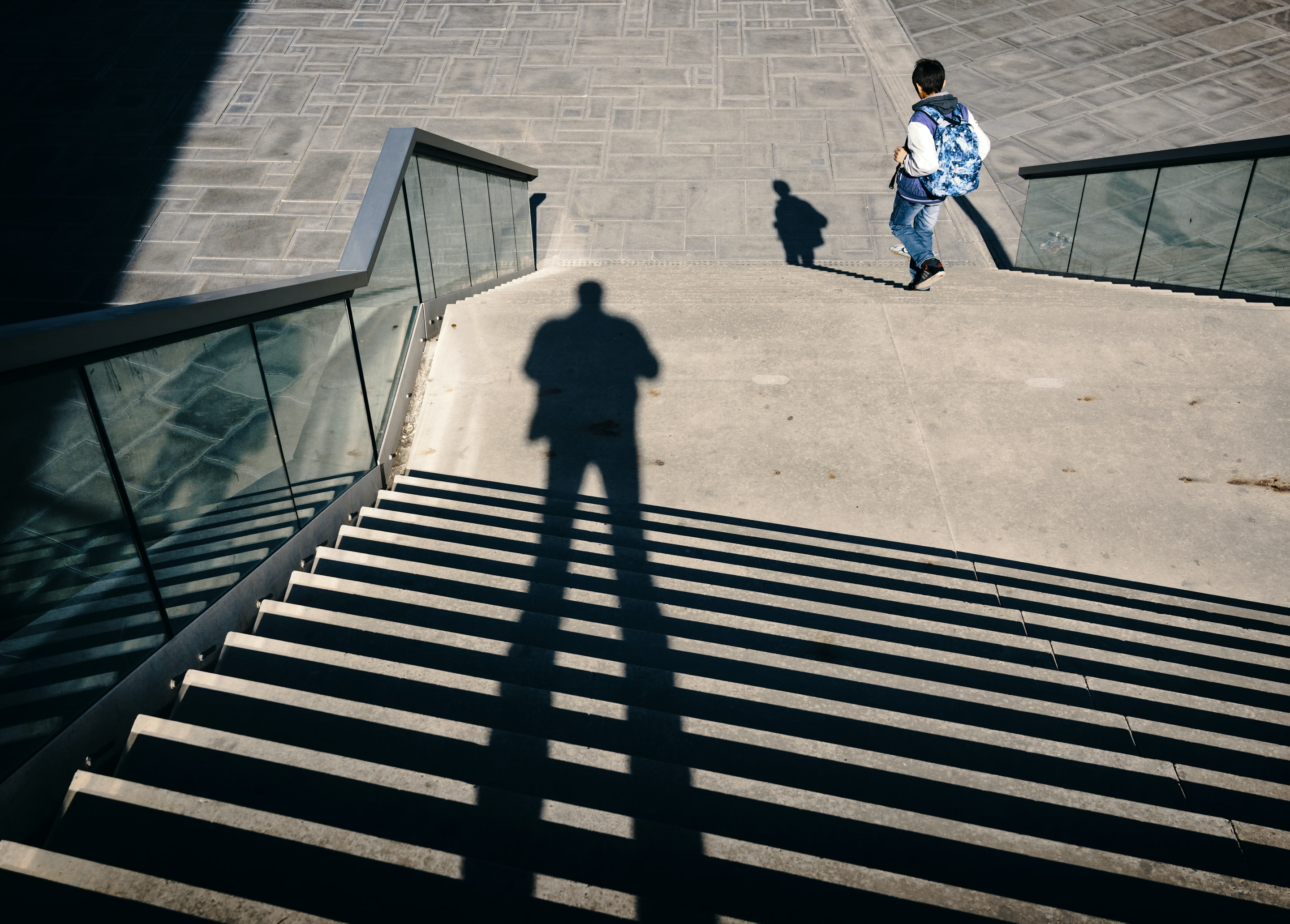 man walking on stairs during daytime