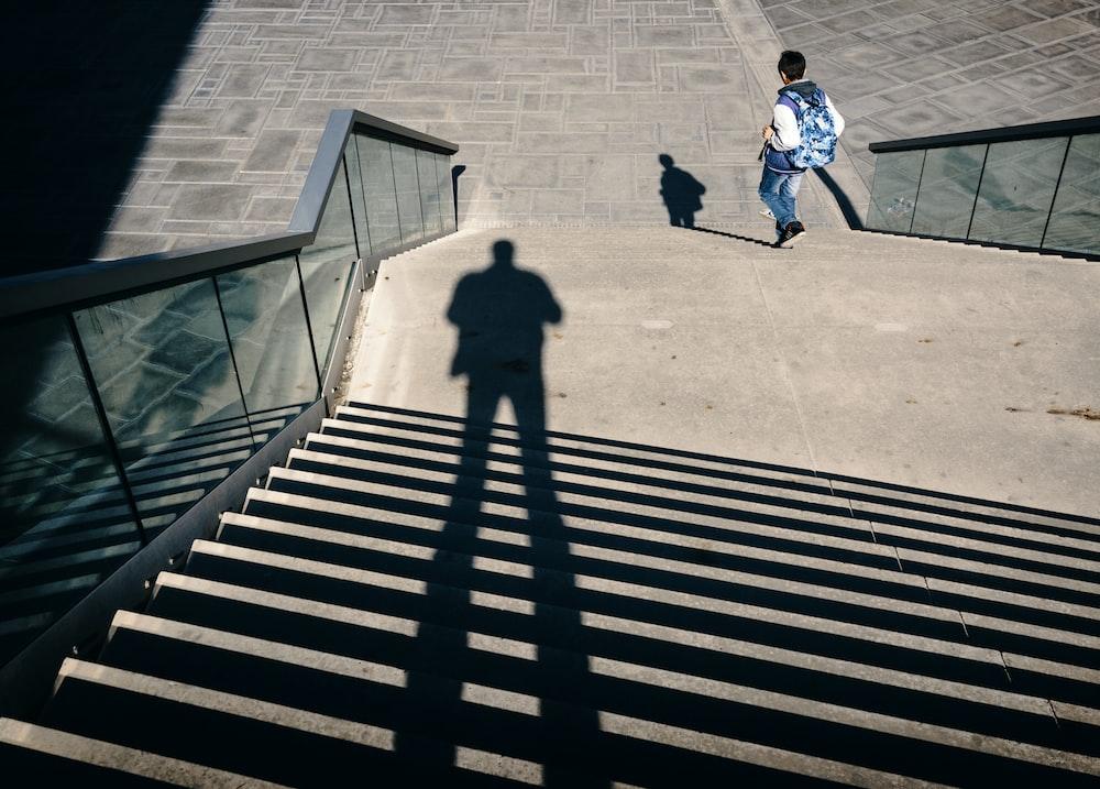 man walking on stairs during daytime
