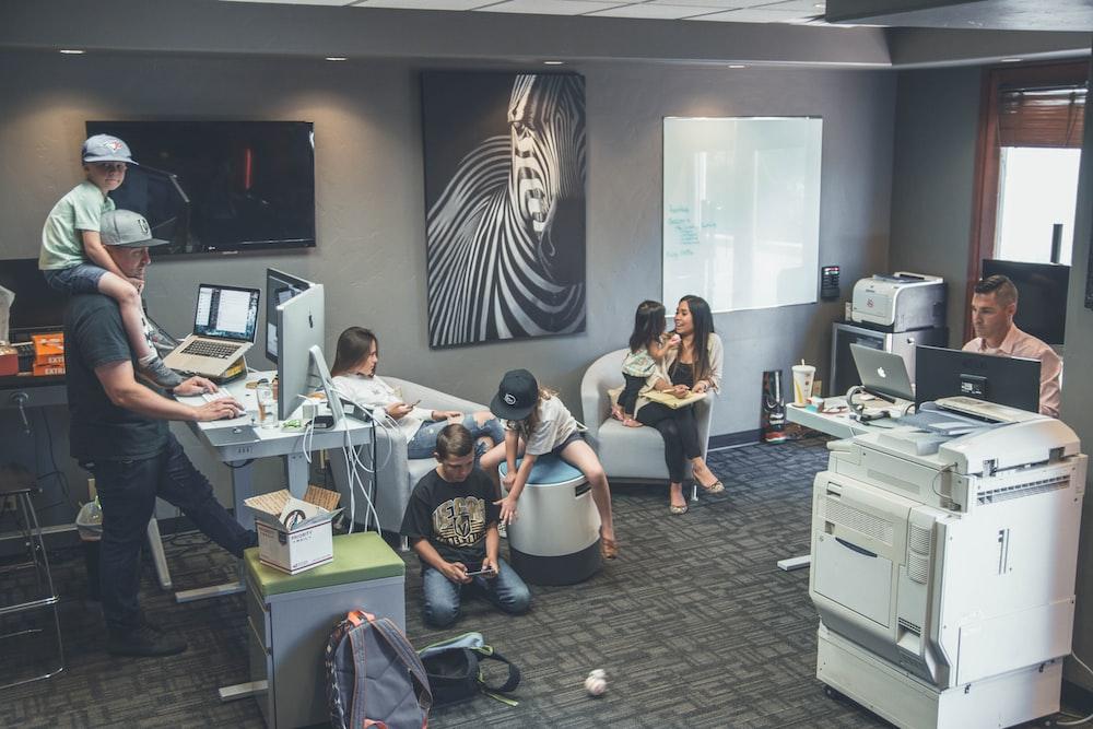 people sitting inside room
