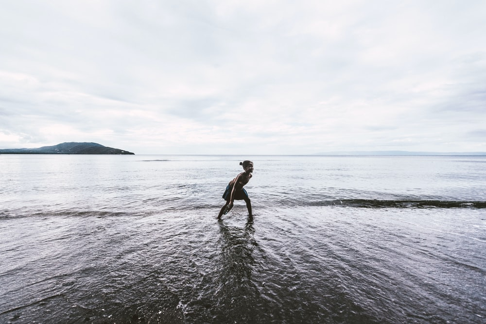 person on body of water standing