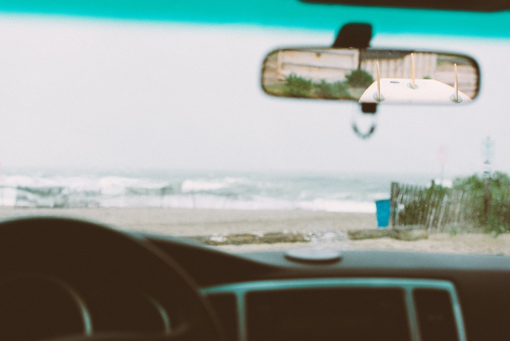 rear view mirror displaying surfboard