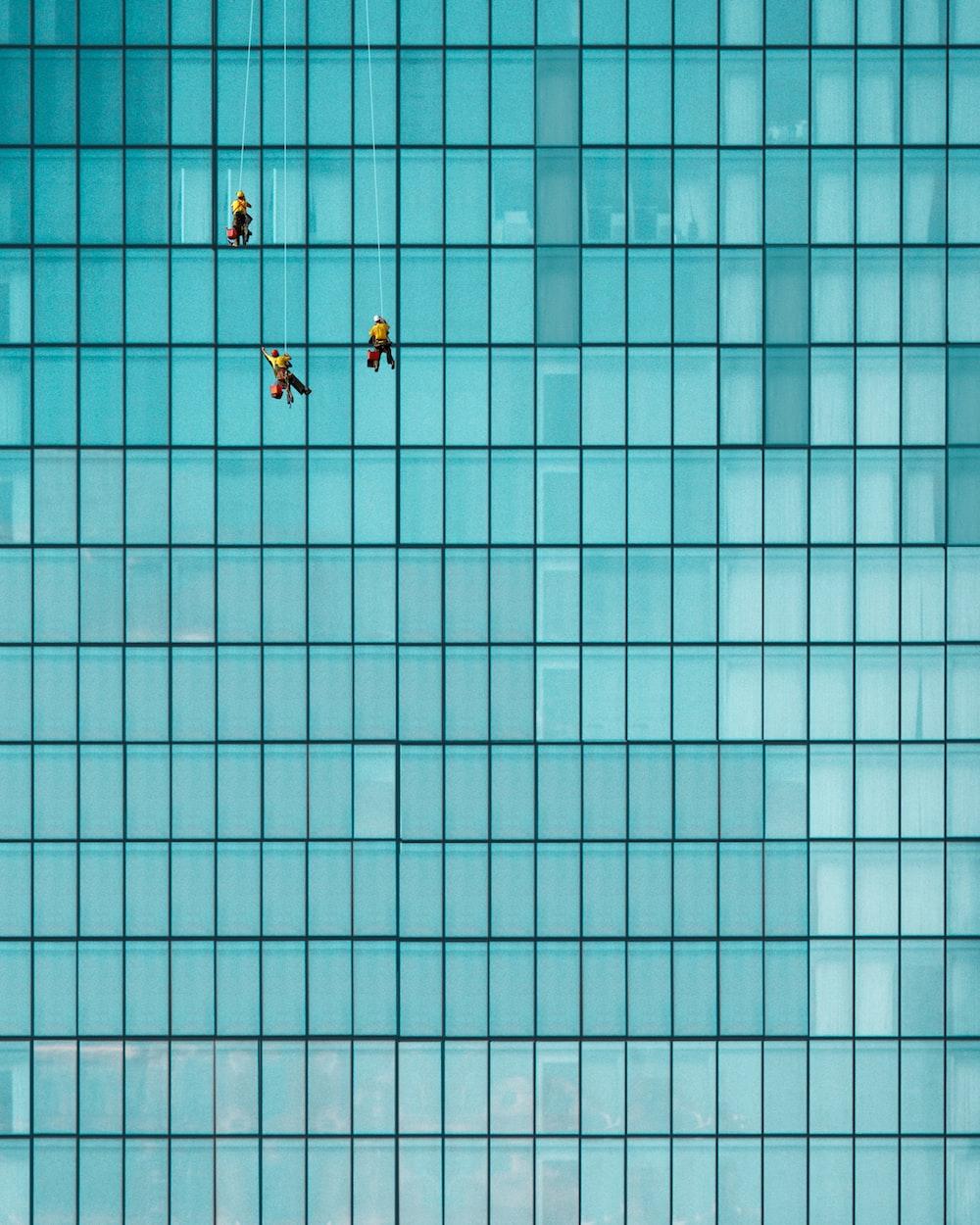 three men cleaning windows