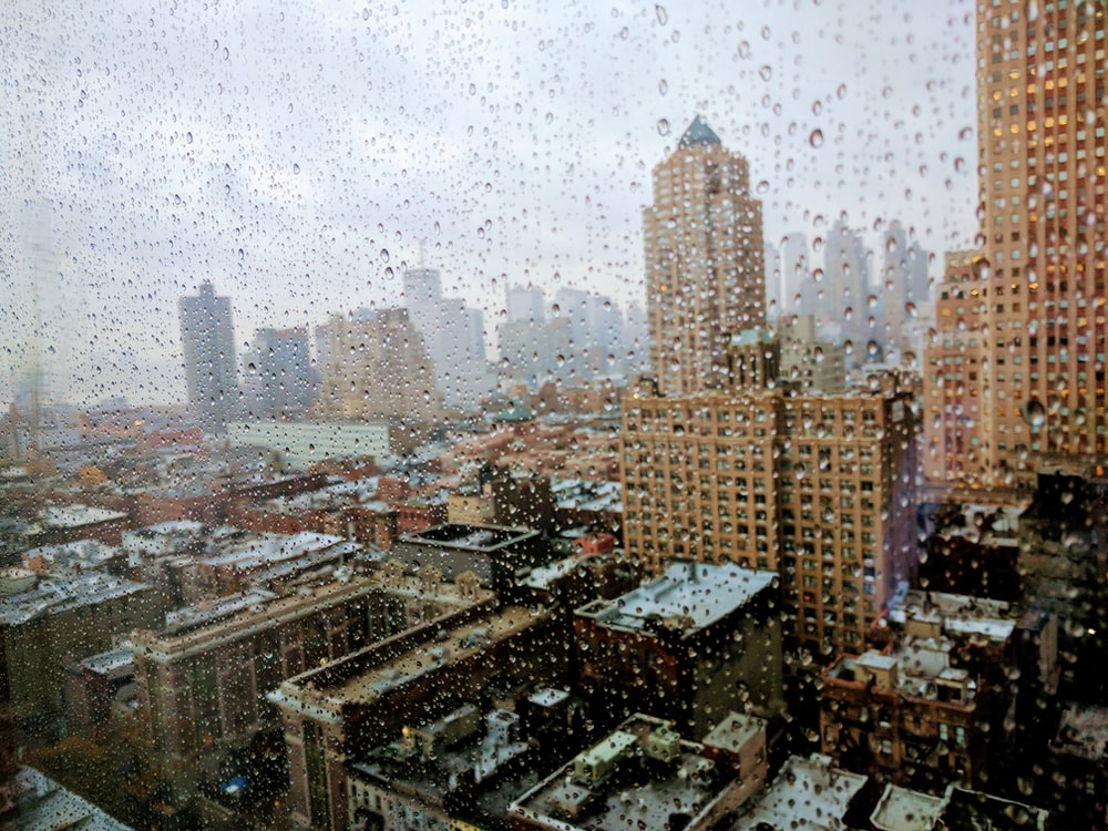 aerial photography of city while raining photography