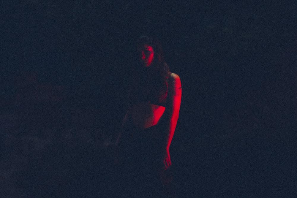 silhouette of woman wearing black top
