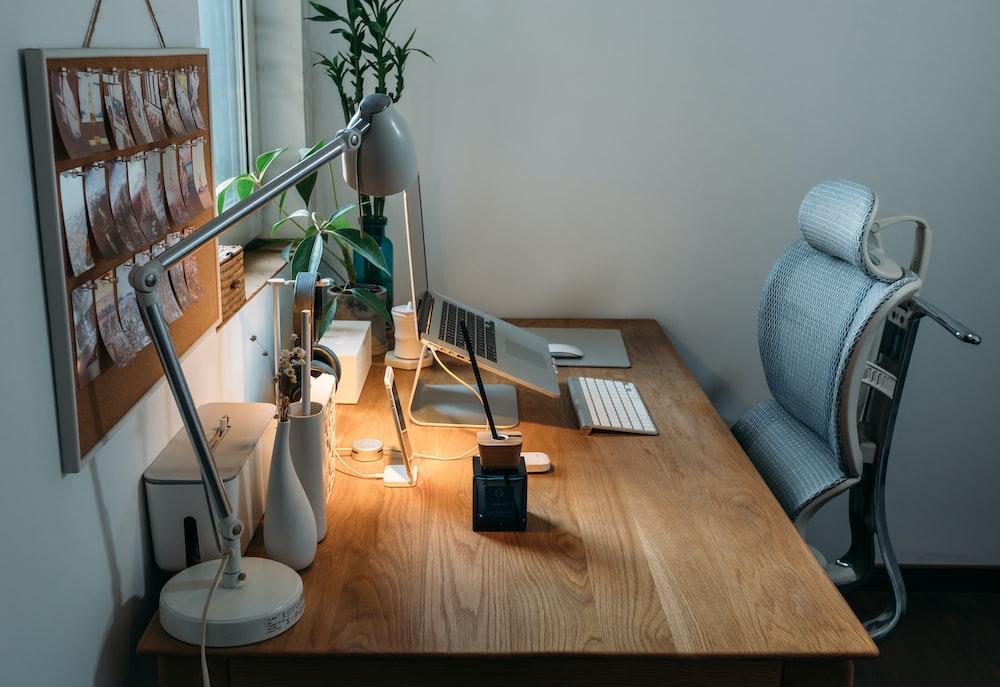 grey desk lamp on top of office desk