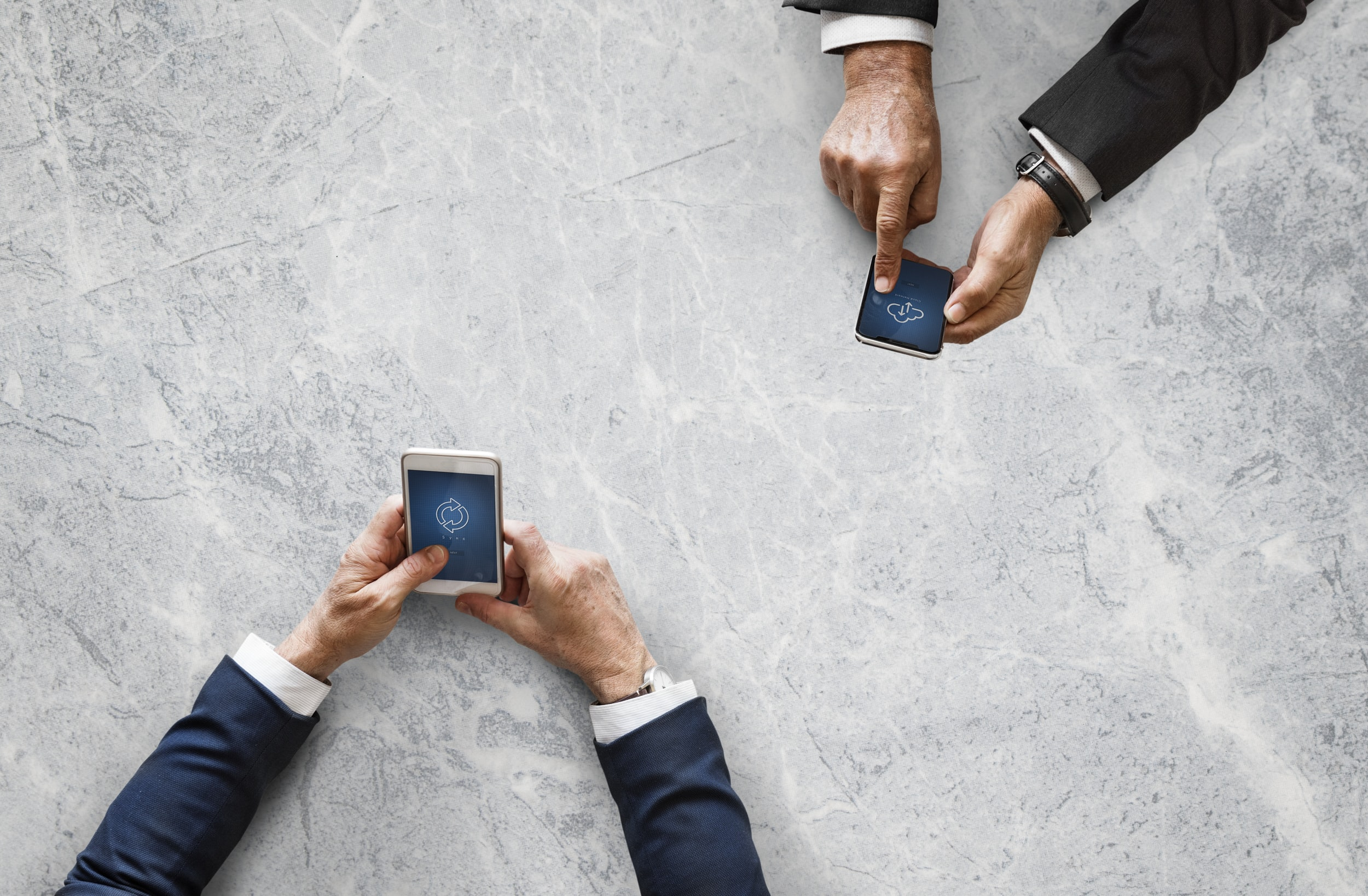 two person holding smartphones