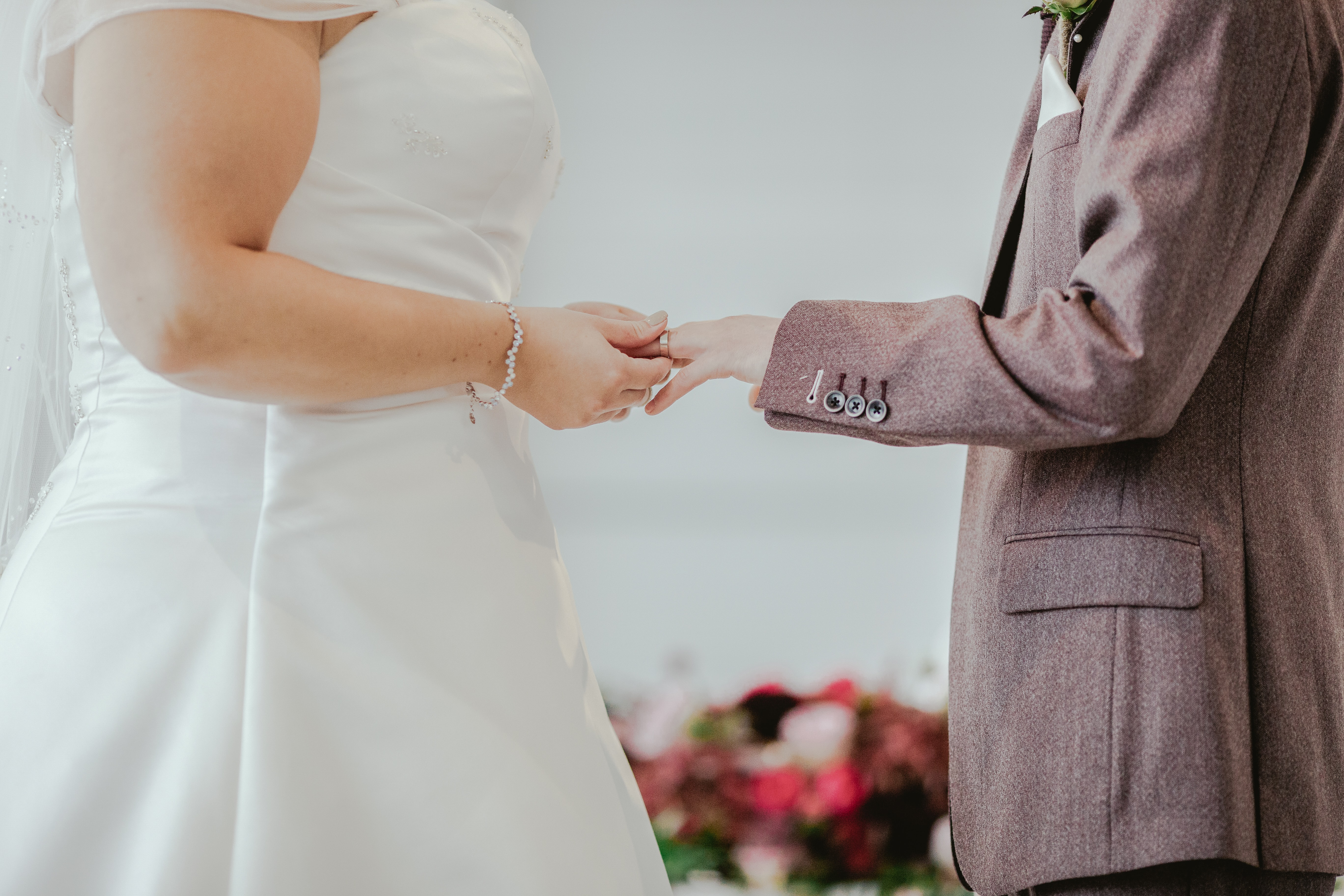 woman holding hands with man in front of altar