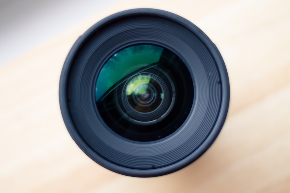 selective focus photography of camera lens
