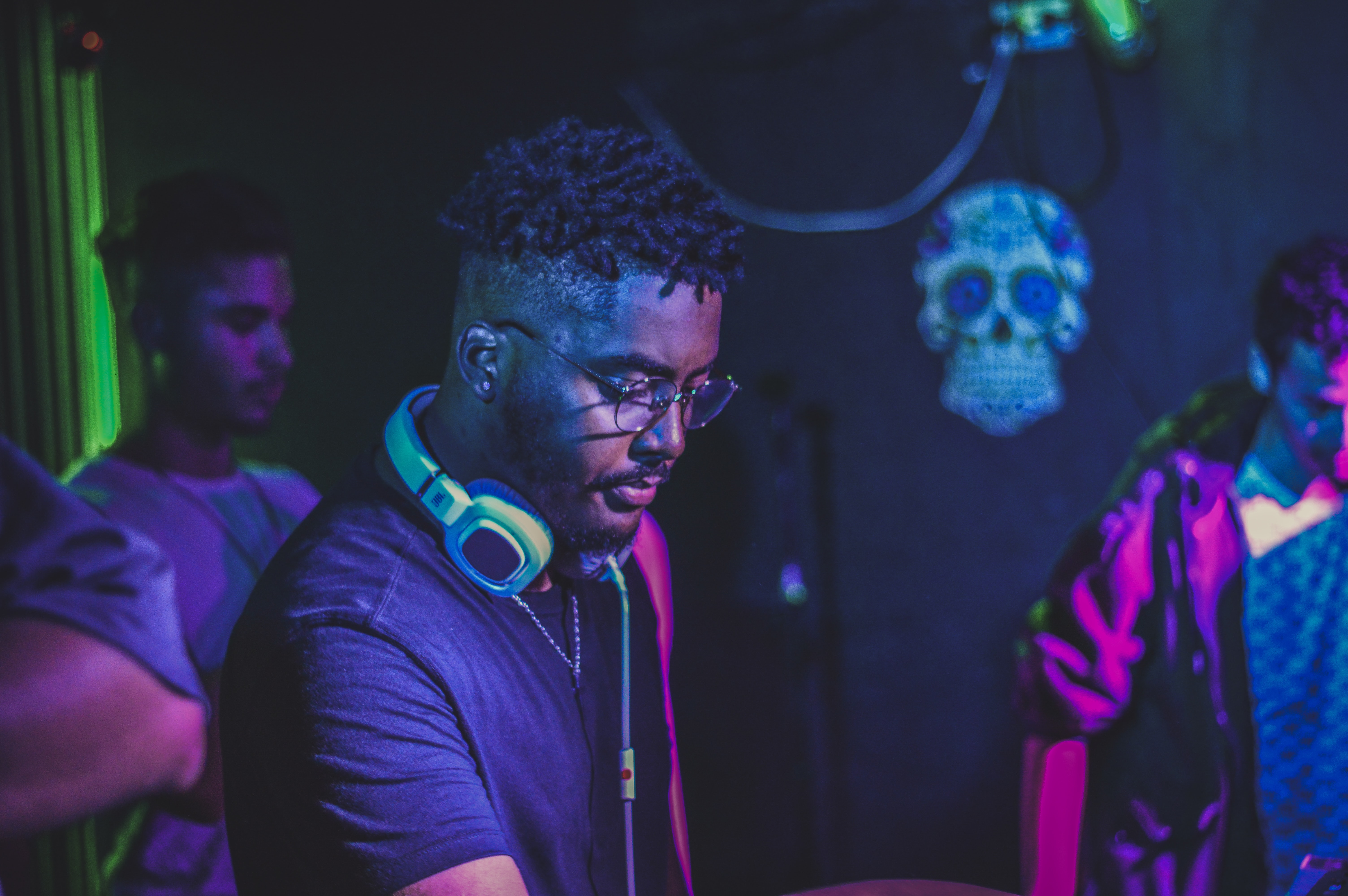 man wearing blue headphones