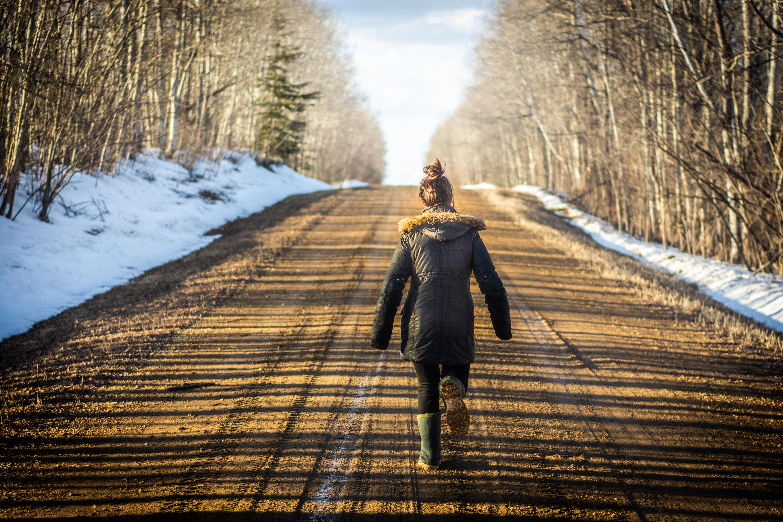 woman walking on road during daytime