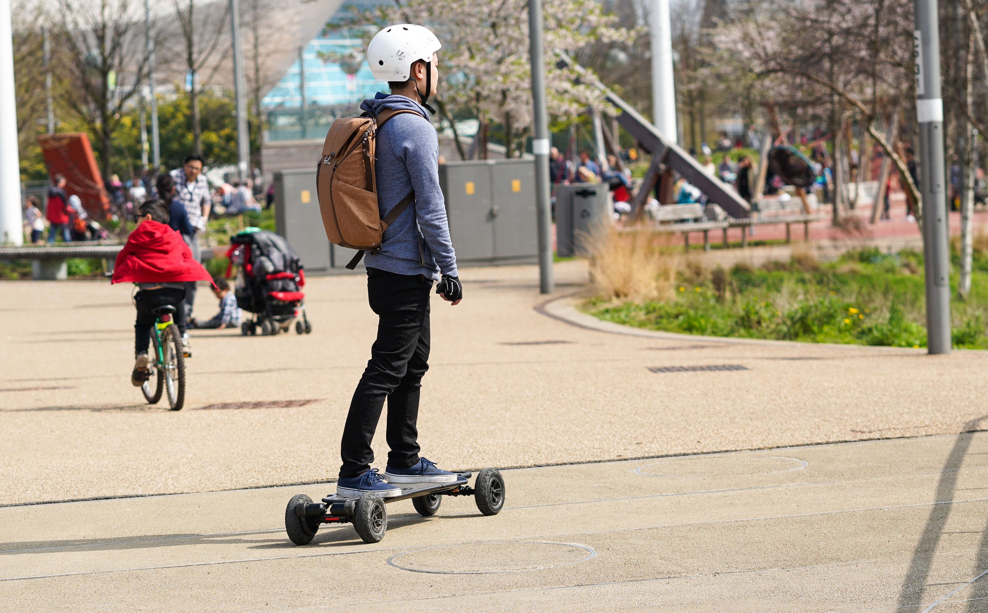 man riding skate on road during daytime