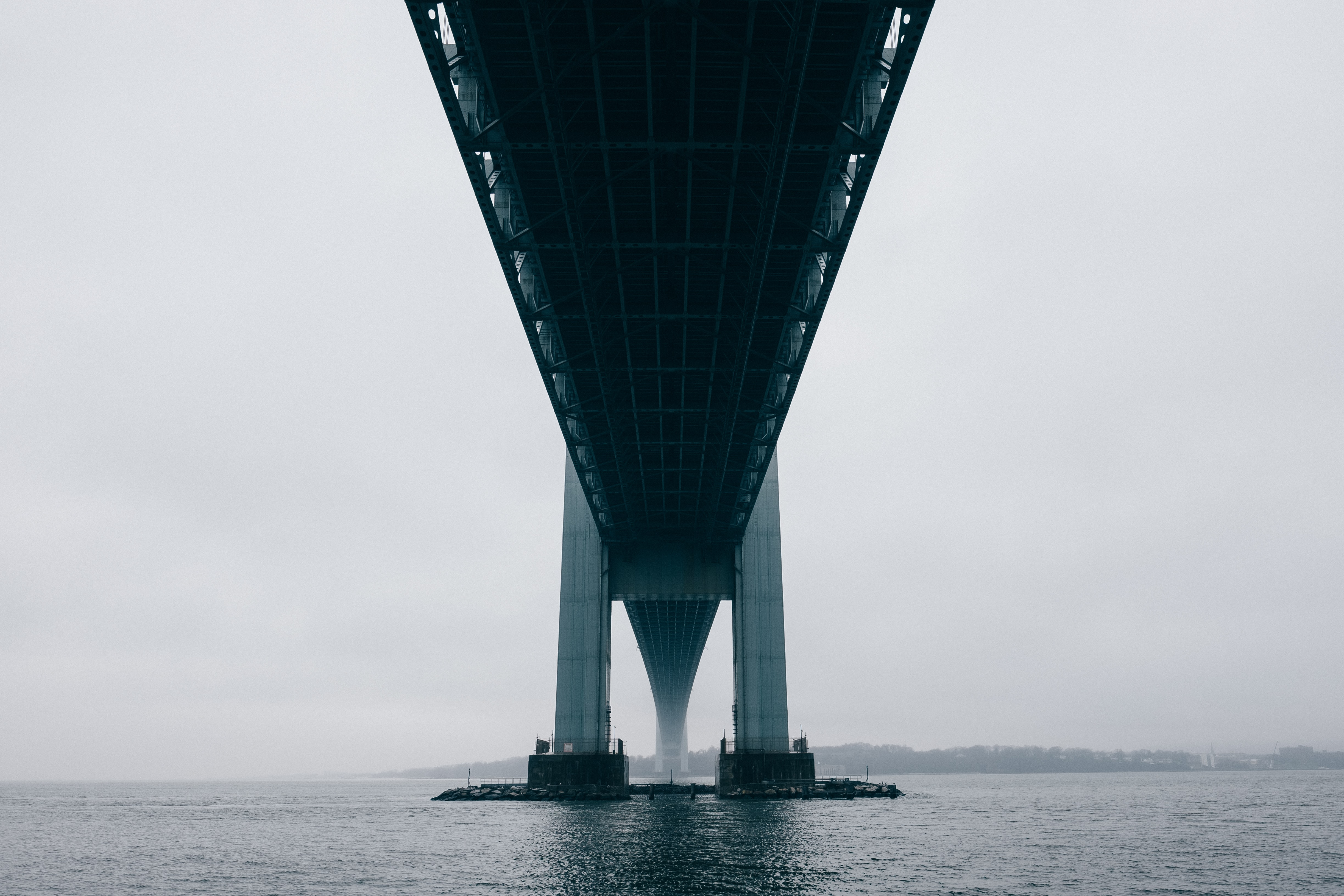 black and gray bridge over body of water