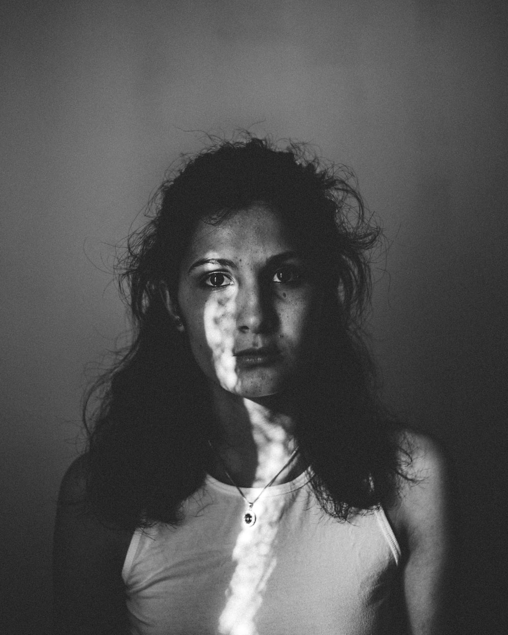 grayscale photography of woman in tank top