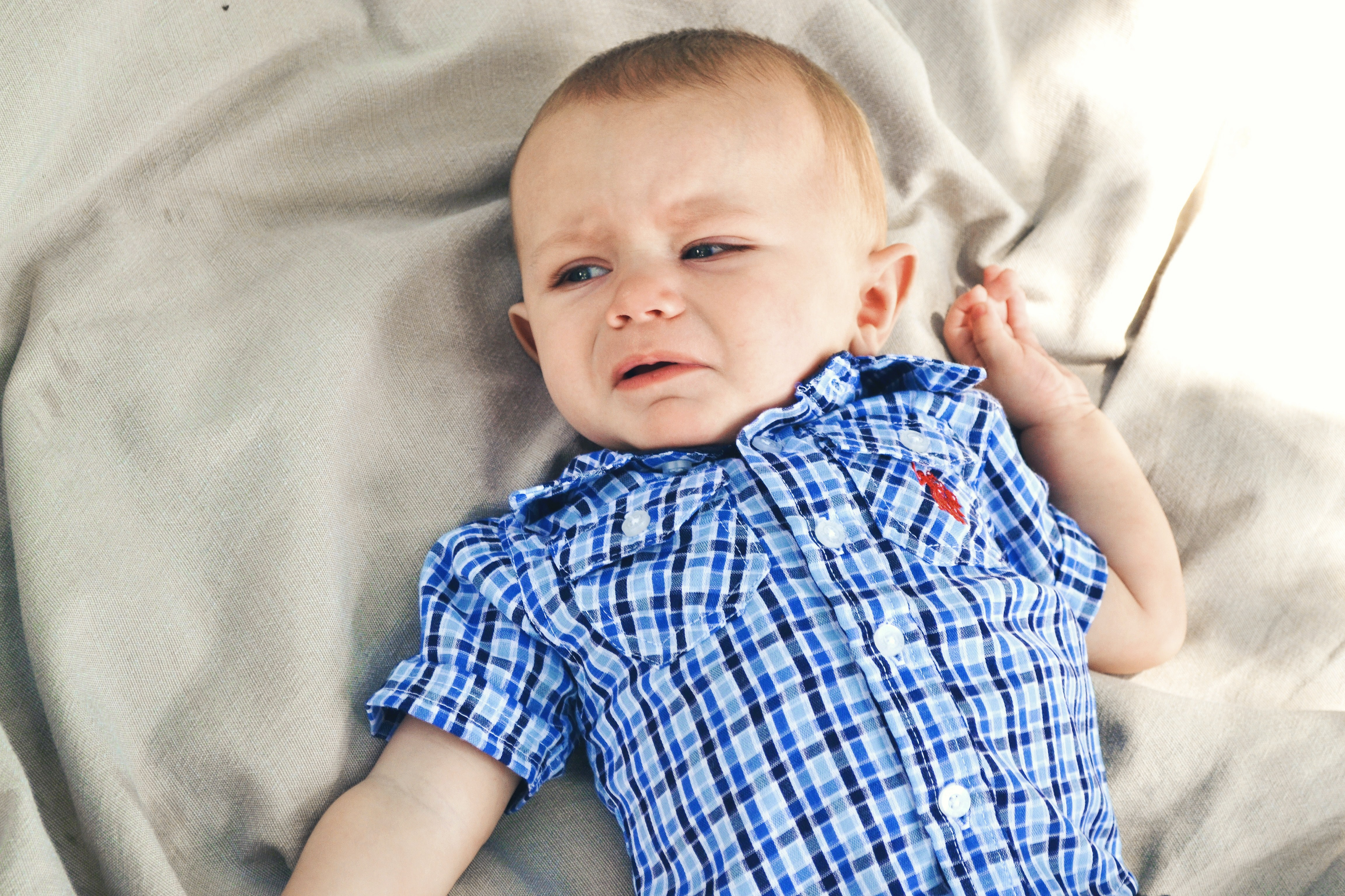 boy wearing blue, black, and gray plaid sport shirt