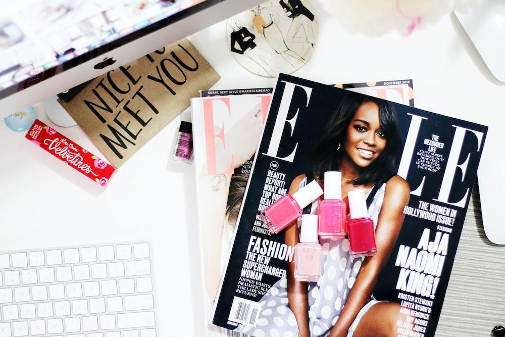 Aja Naomi King! magazine near silver iMac