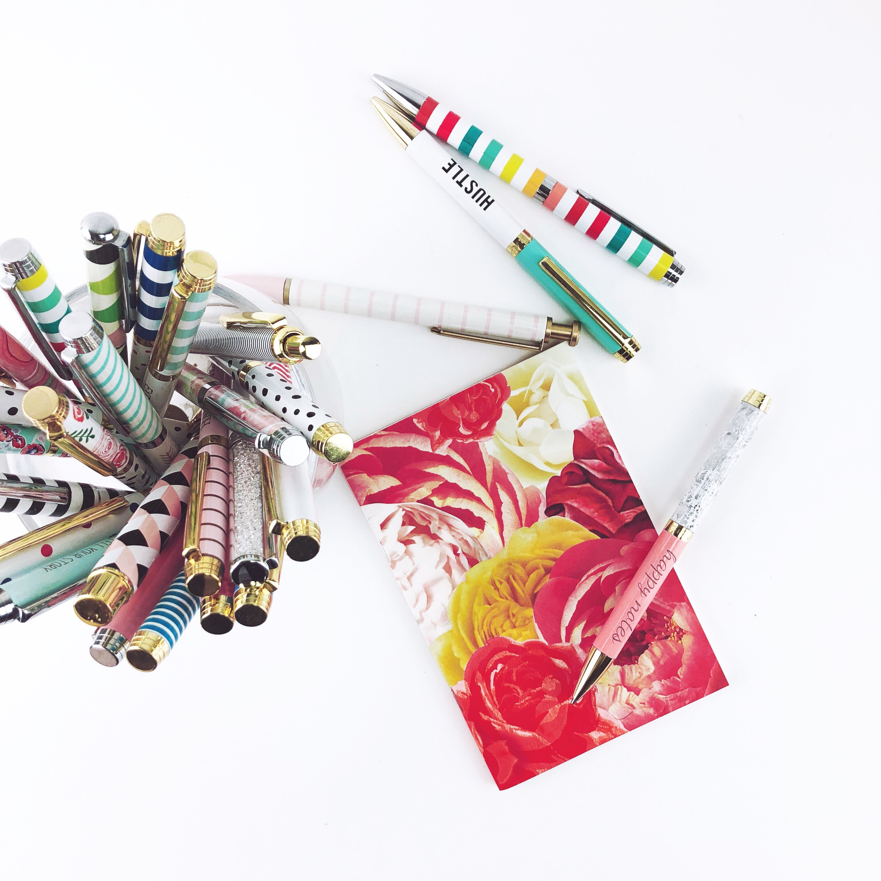 assorted-color retractable pen on white background