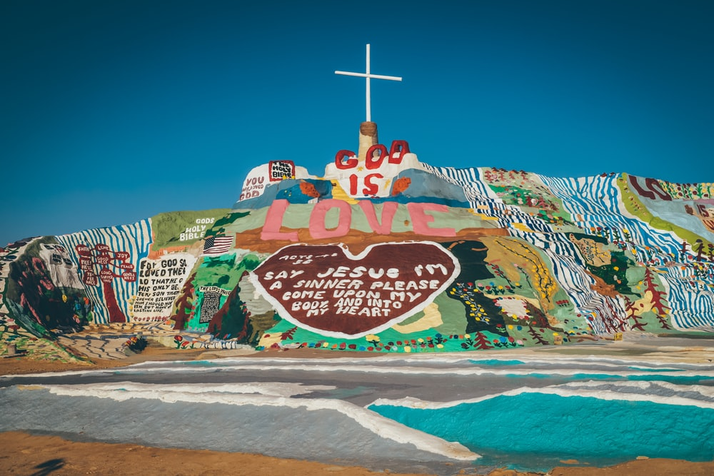 god is love Jesus wall painting during daytime