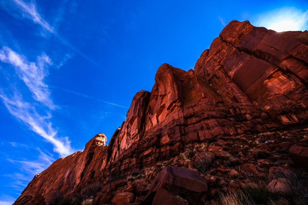 brown rock formation under blue skies