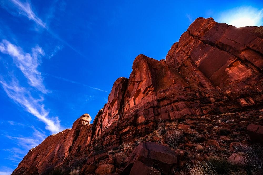 brown rock formation under blue skies