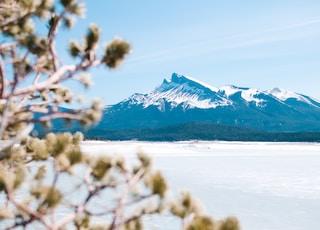 photo of mountain under white sky