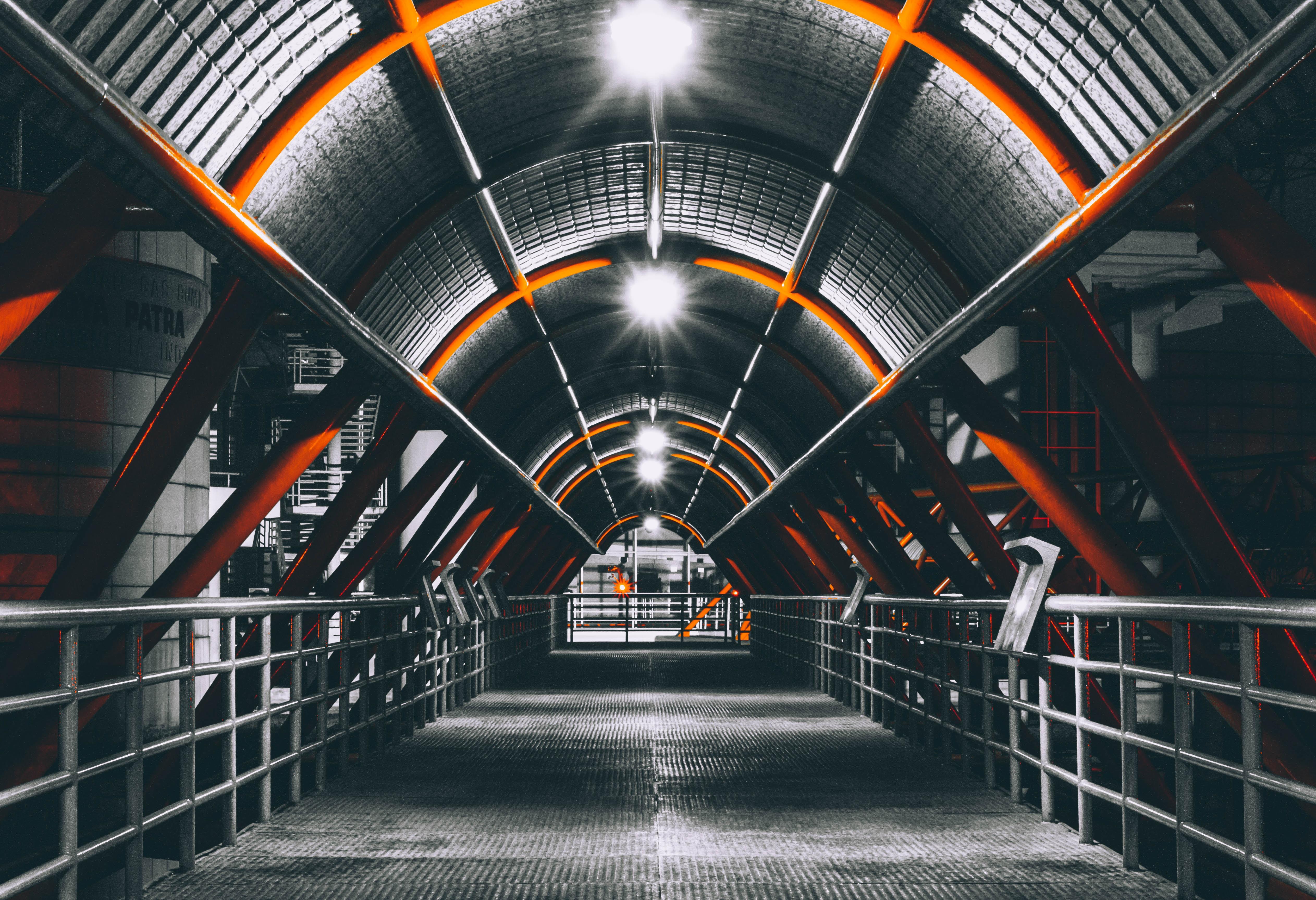 pathway between steel railings tunnel