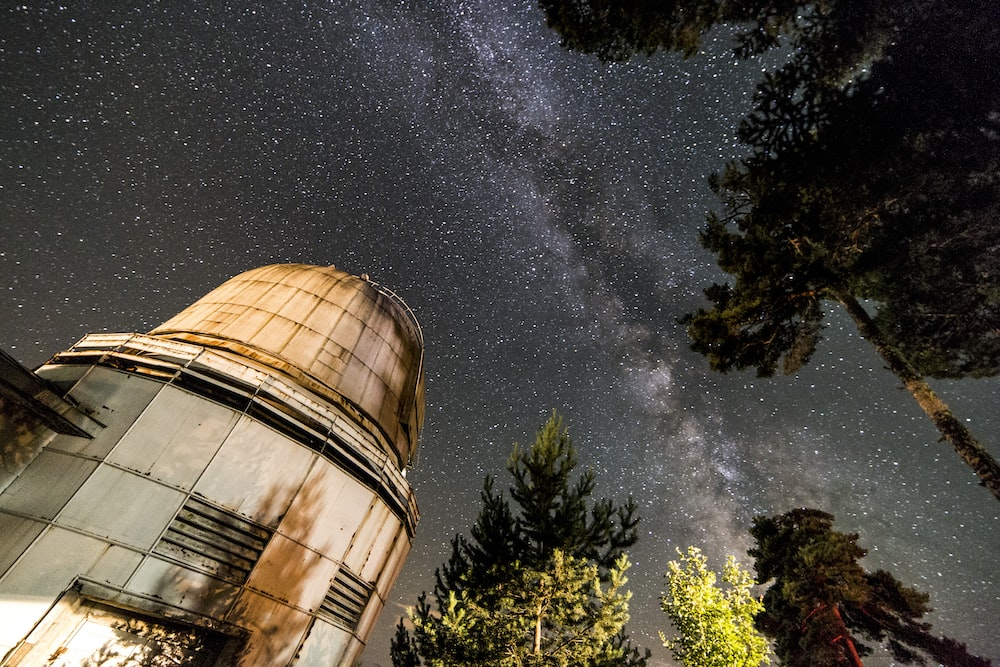 brown concrete dome building during night time