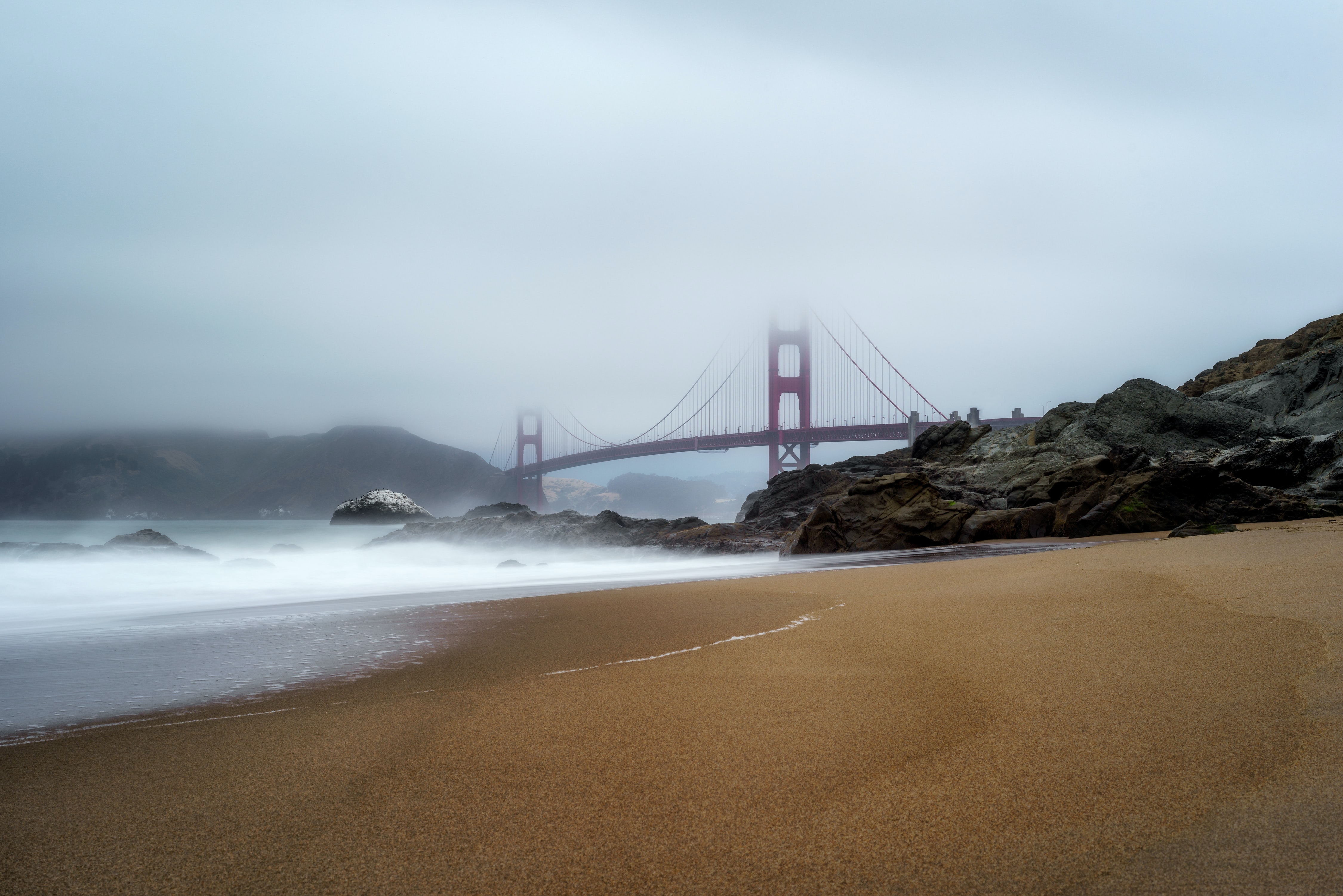 Golden Gate Bridge covered by fogs