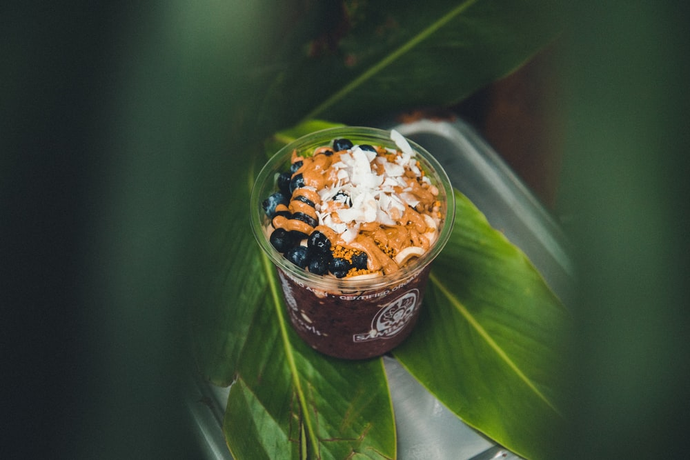 drink with blueberries and shredded coconut in macro photography