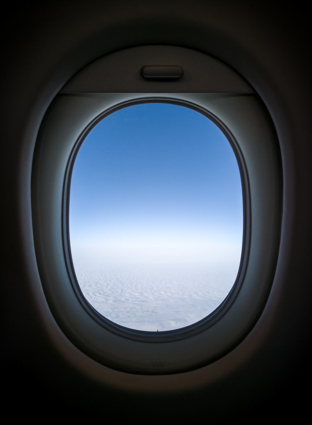 clear white skies from plane's window view