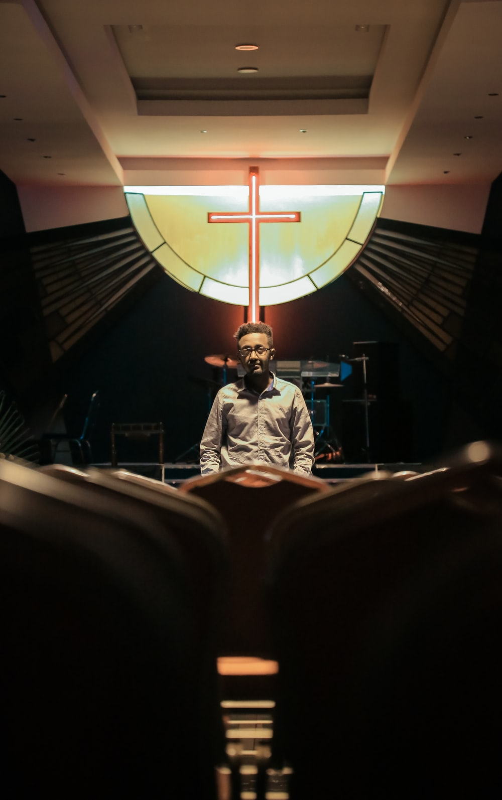 man standing inside church