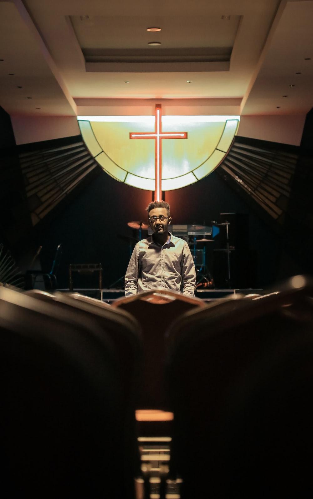 man standing inside church