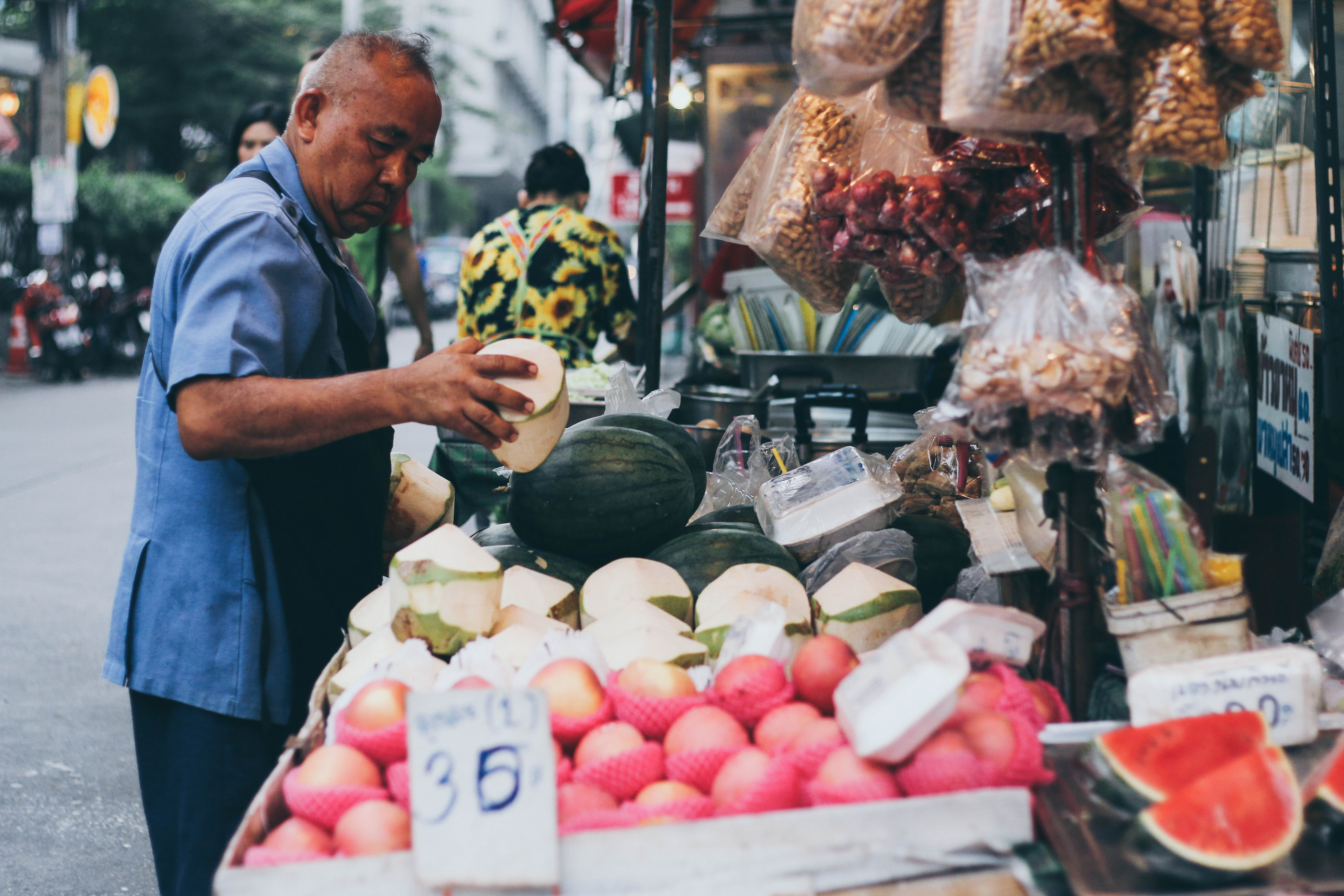man buying fruits on store