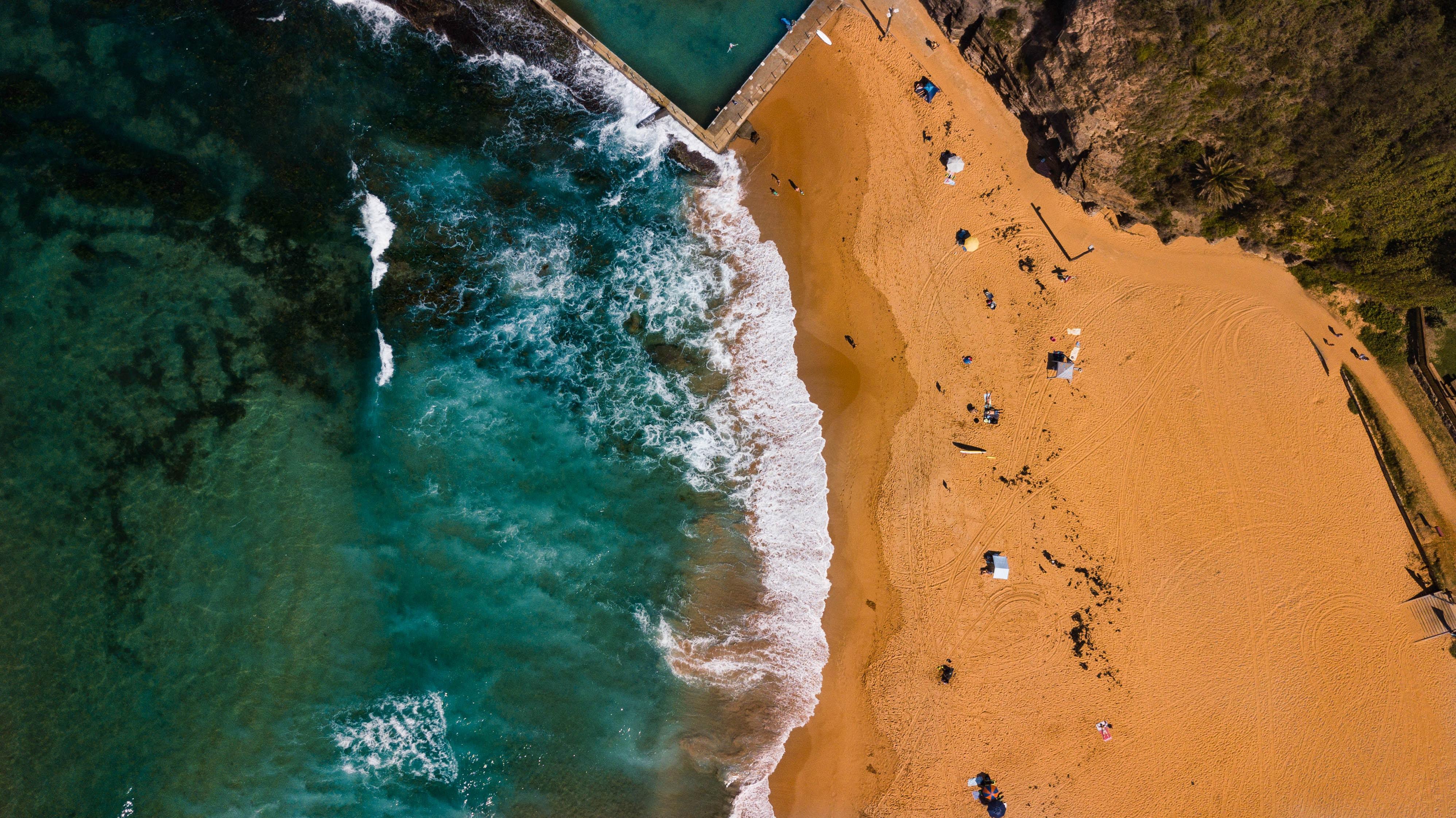 aerial photo of brown sand beach