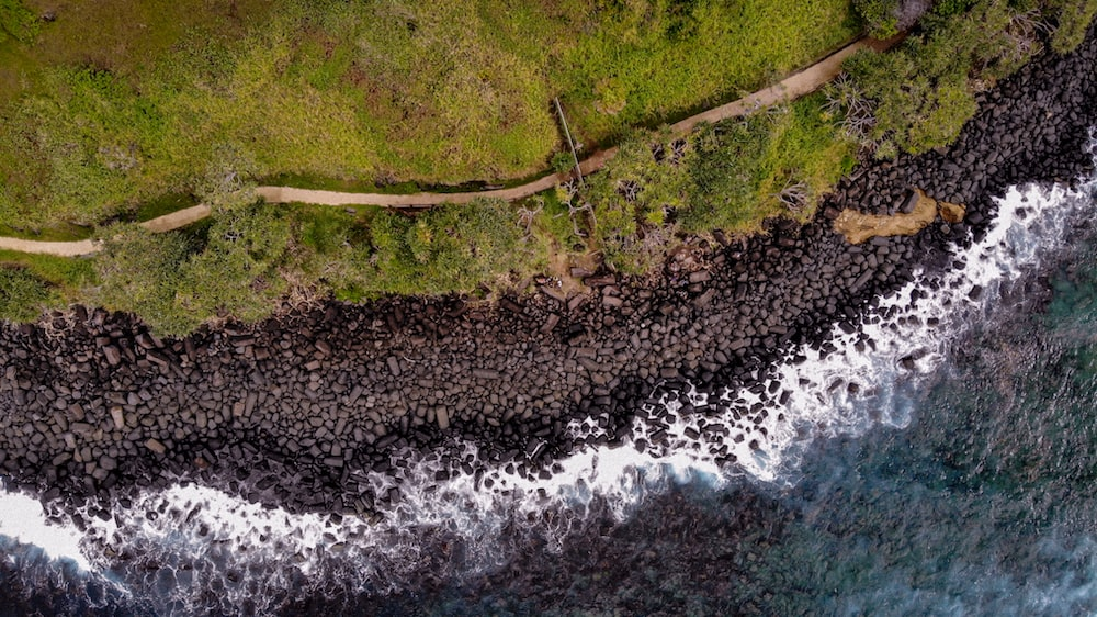 aerial photography of shoreline with rocks