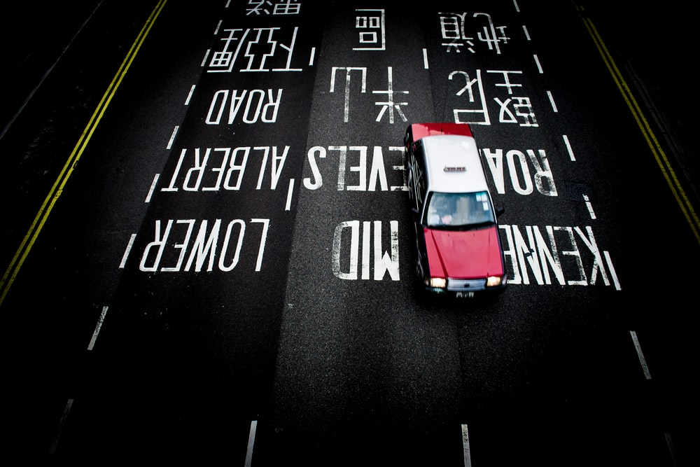 red and white car on road