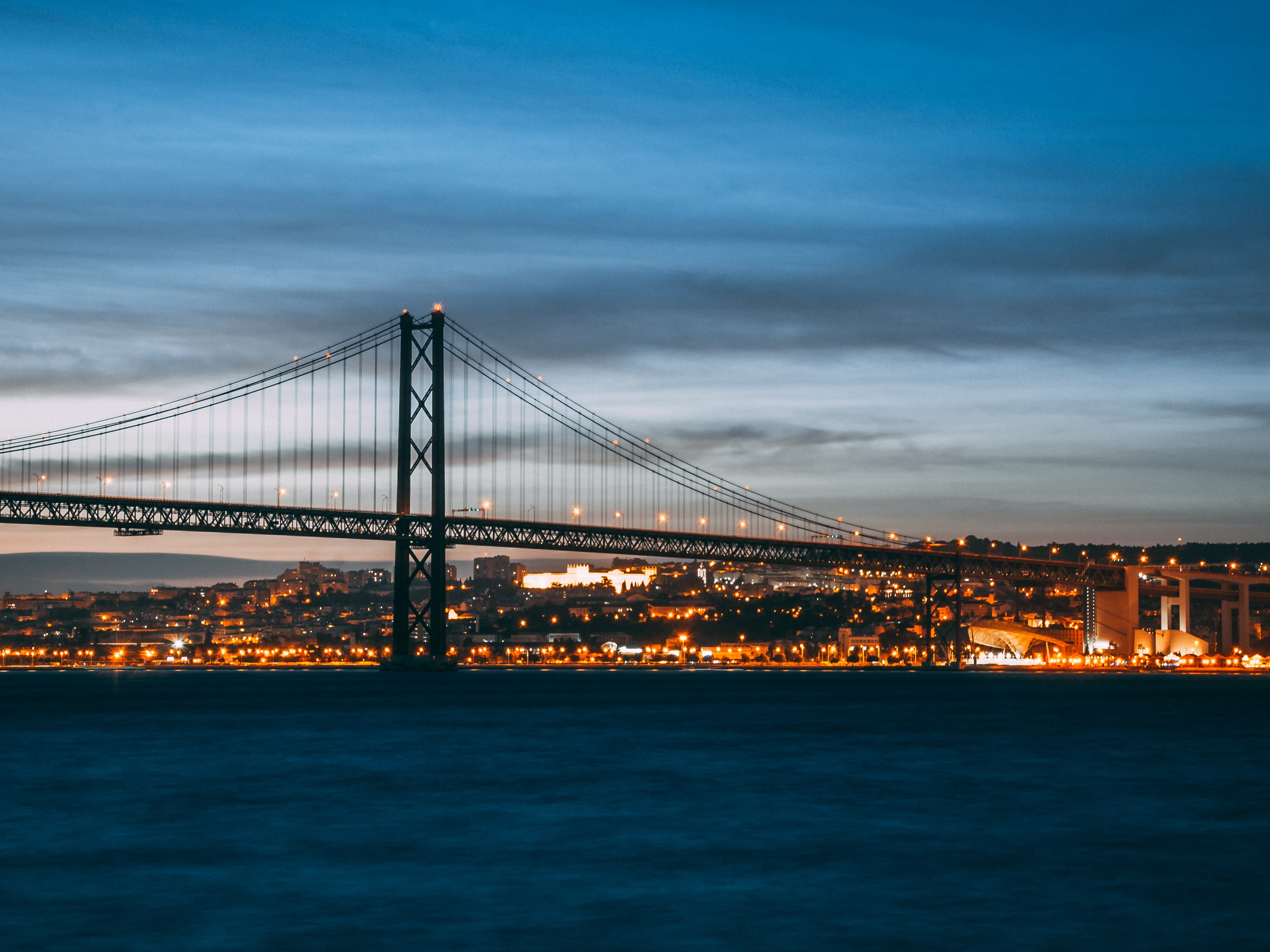 concrete bridge at night time