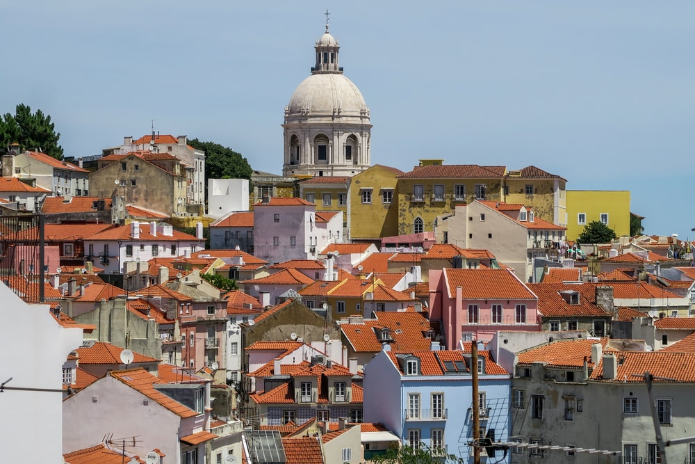 aerial photography of town with red roof houses near dome gothic cathedral