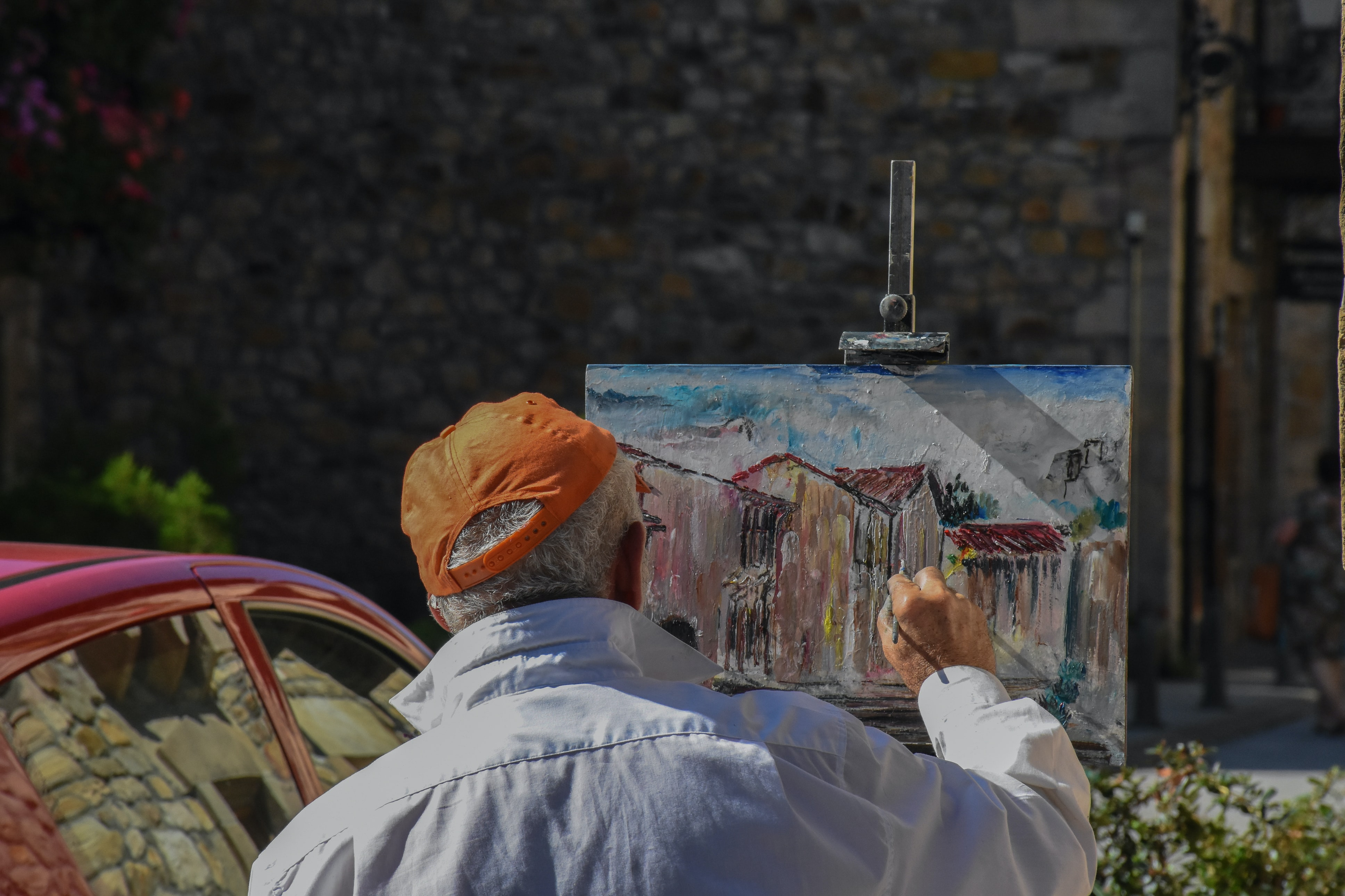man painting house in front of house