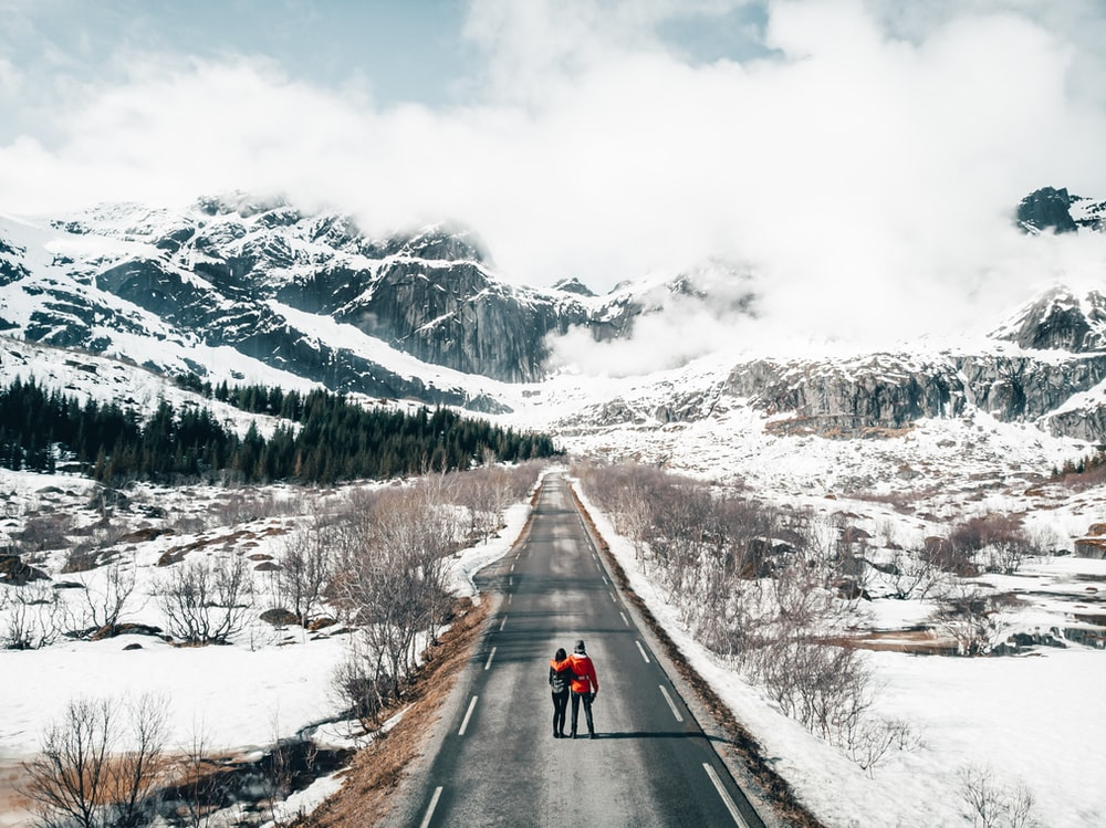 couple standing on road during daytime