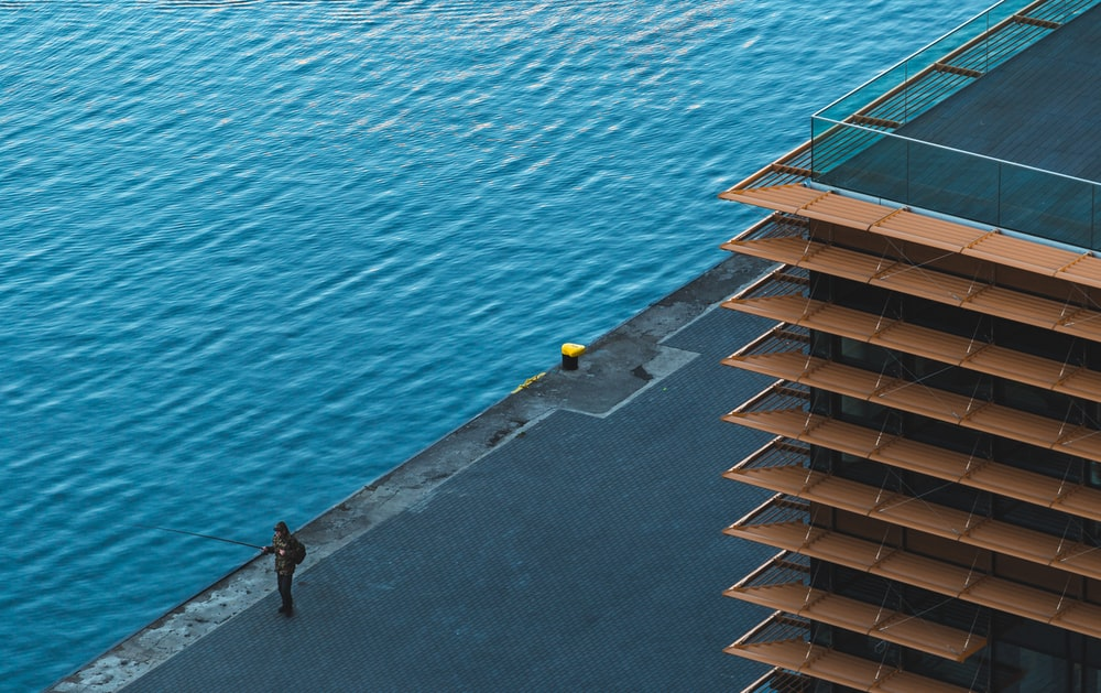 top view photography of construct building near body of water