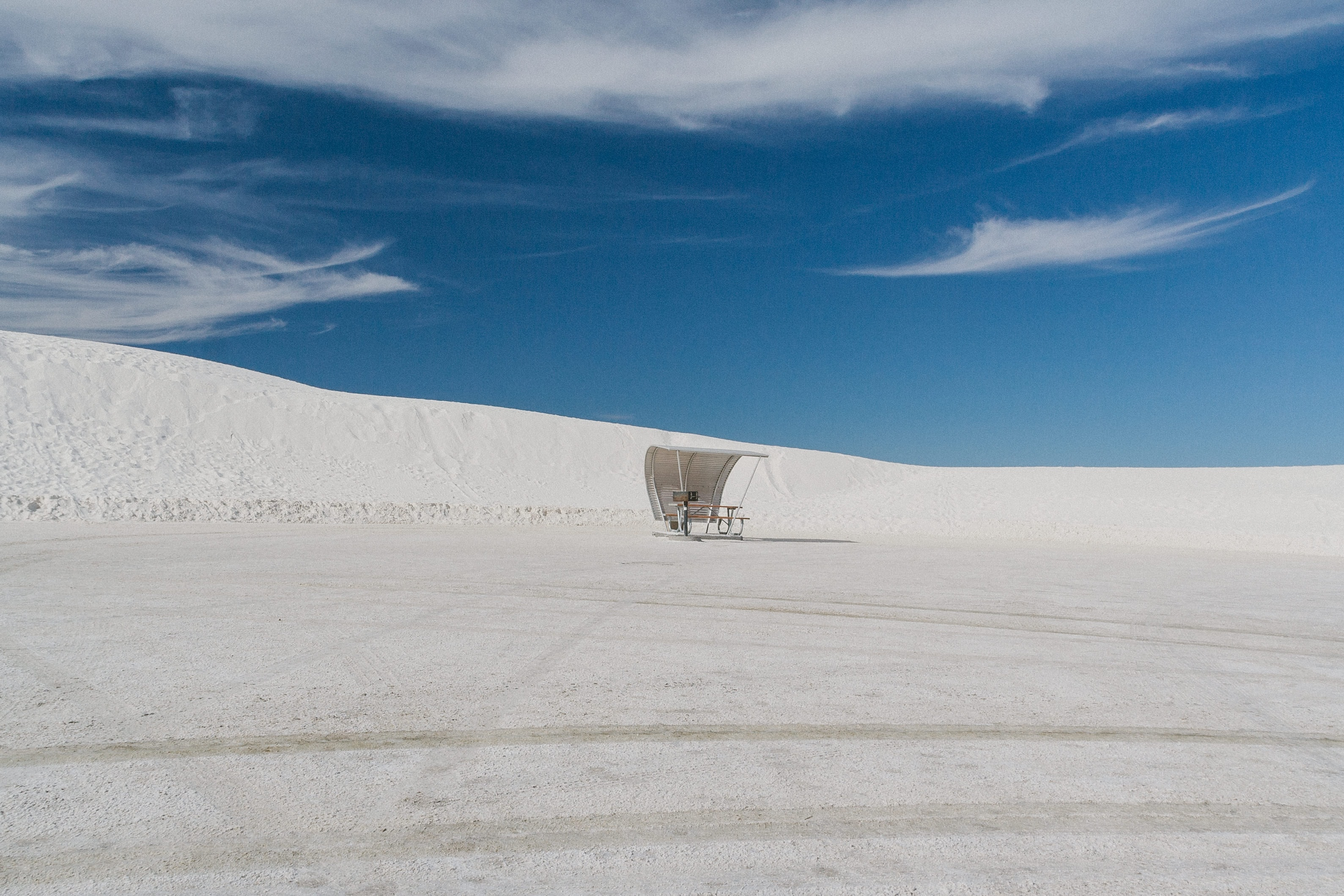 photo of desert under white and blue sky