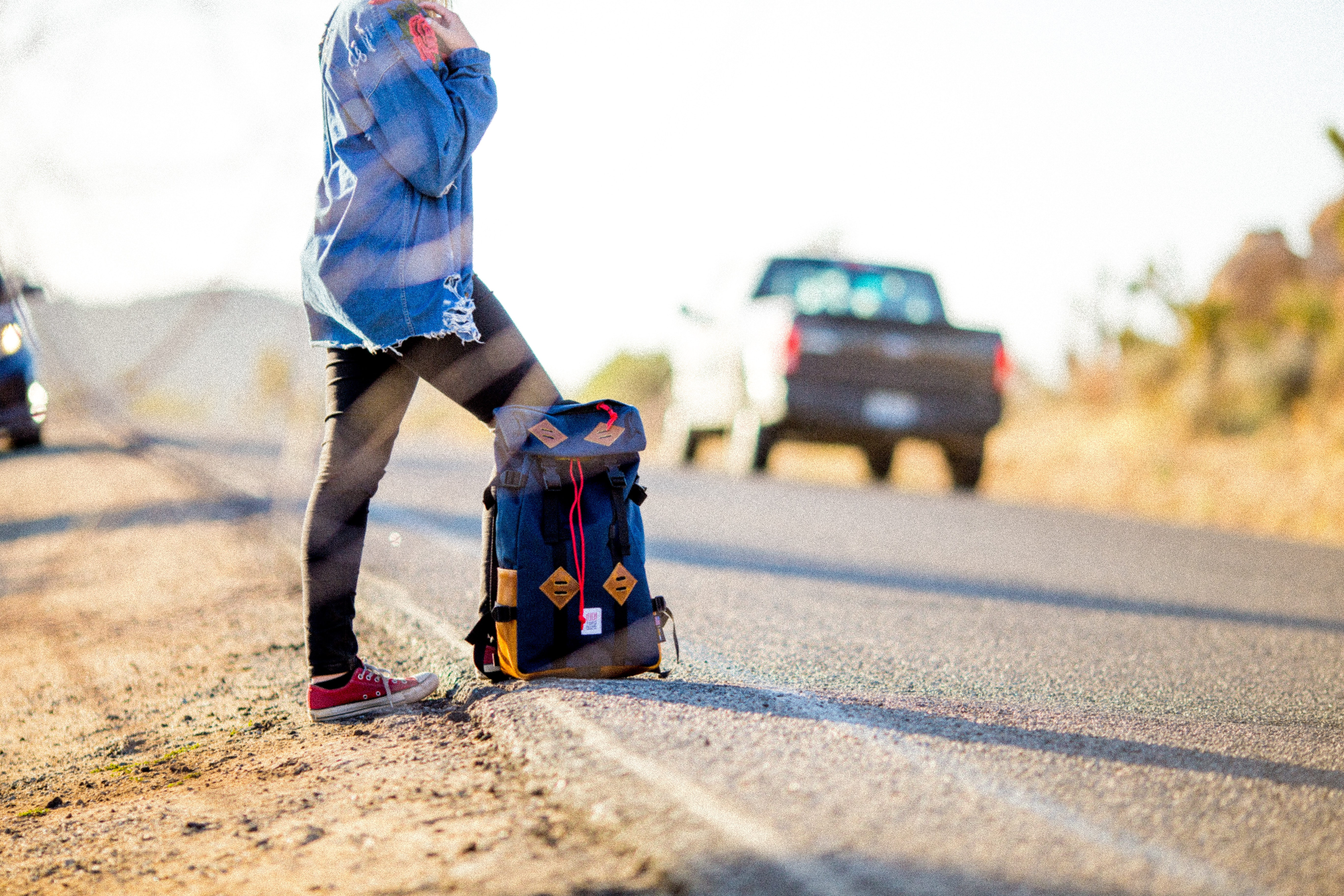 black and blue backpack on road